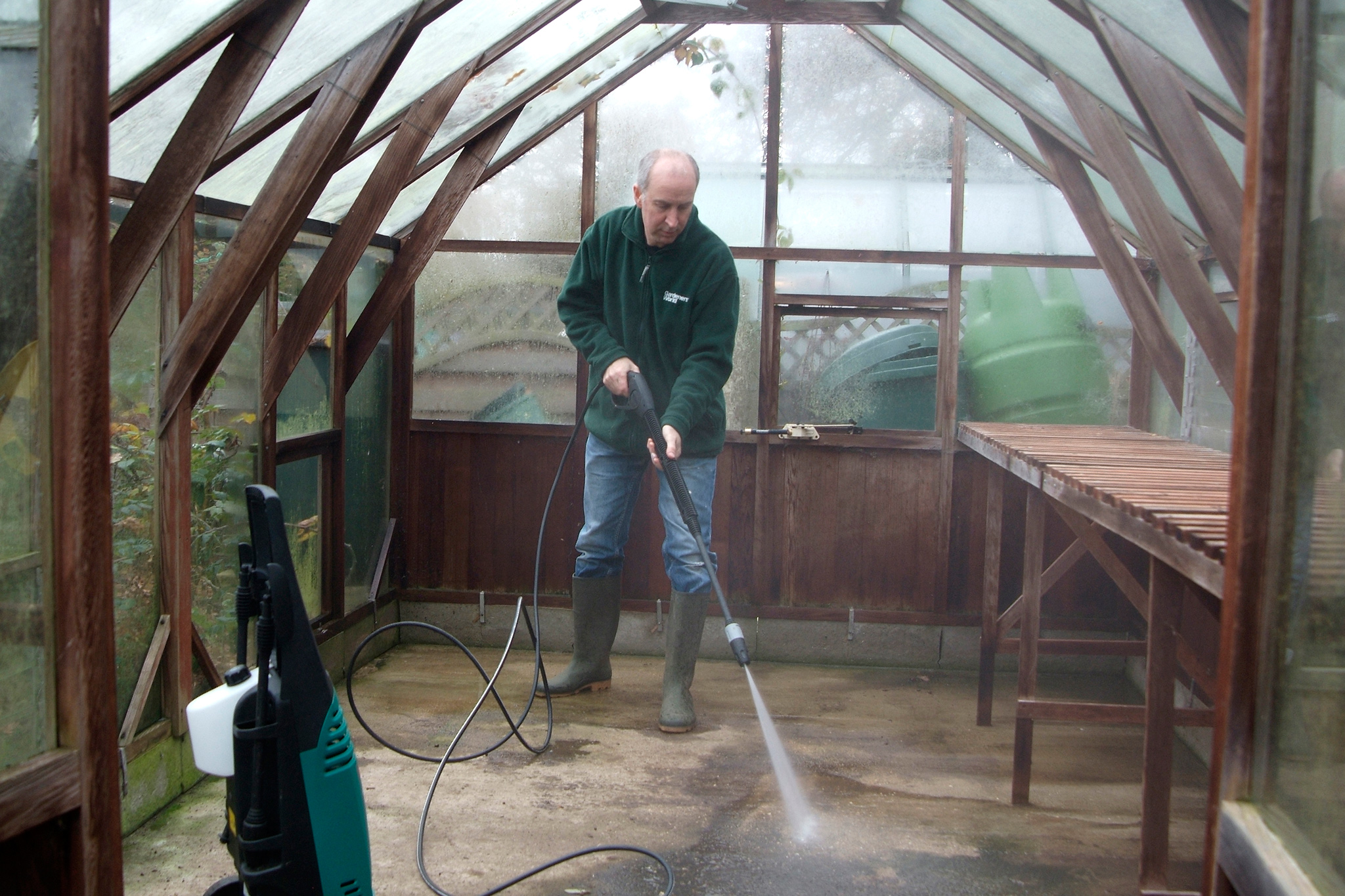 pressure-washing-the-greenhouse-2