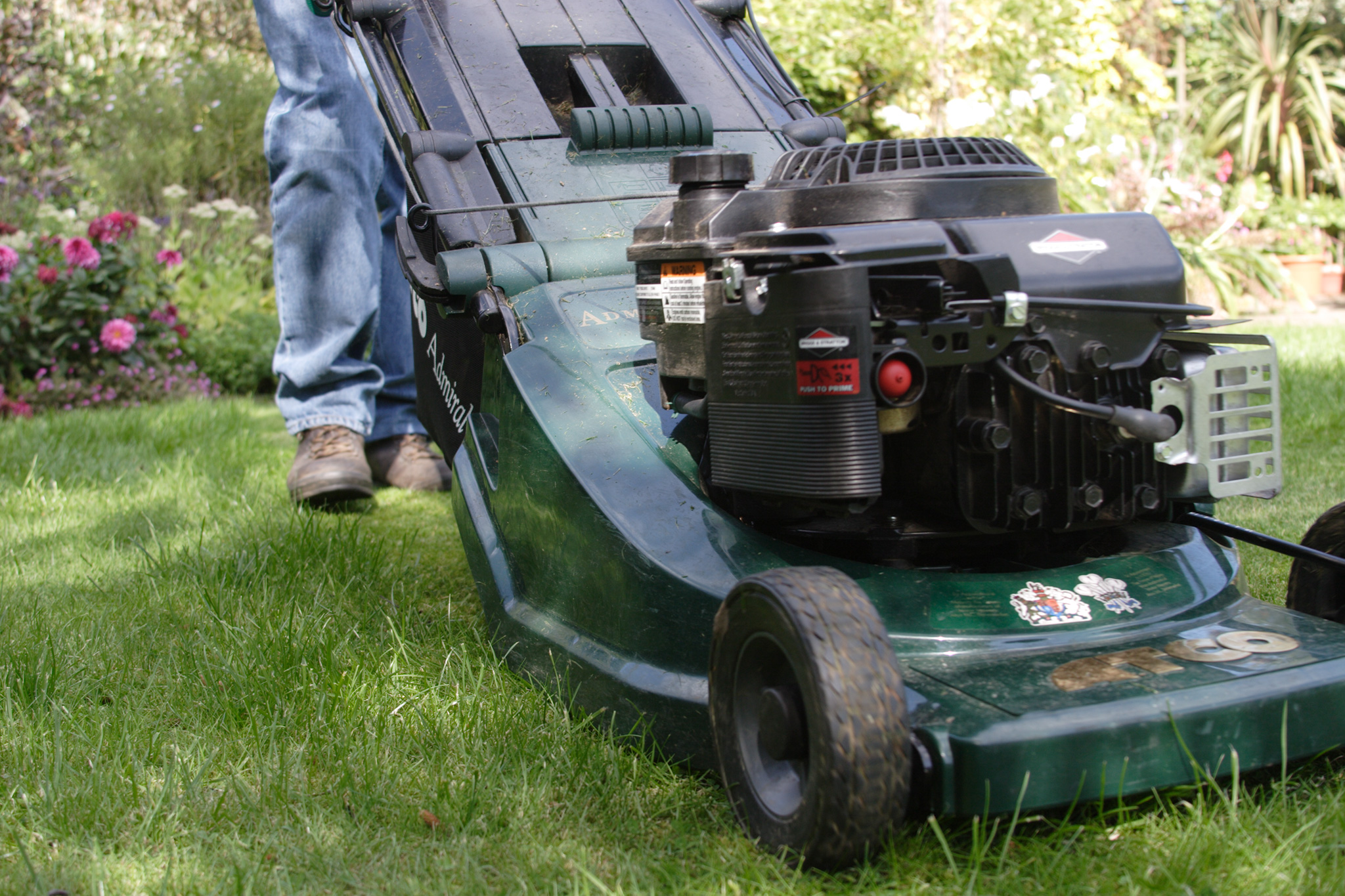 Raise the mower blades to keep grass long