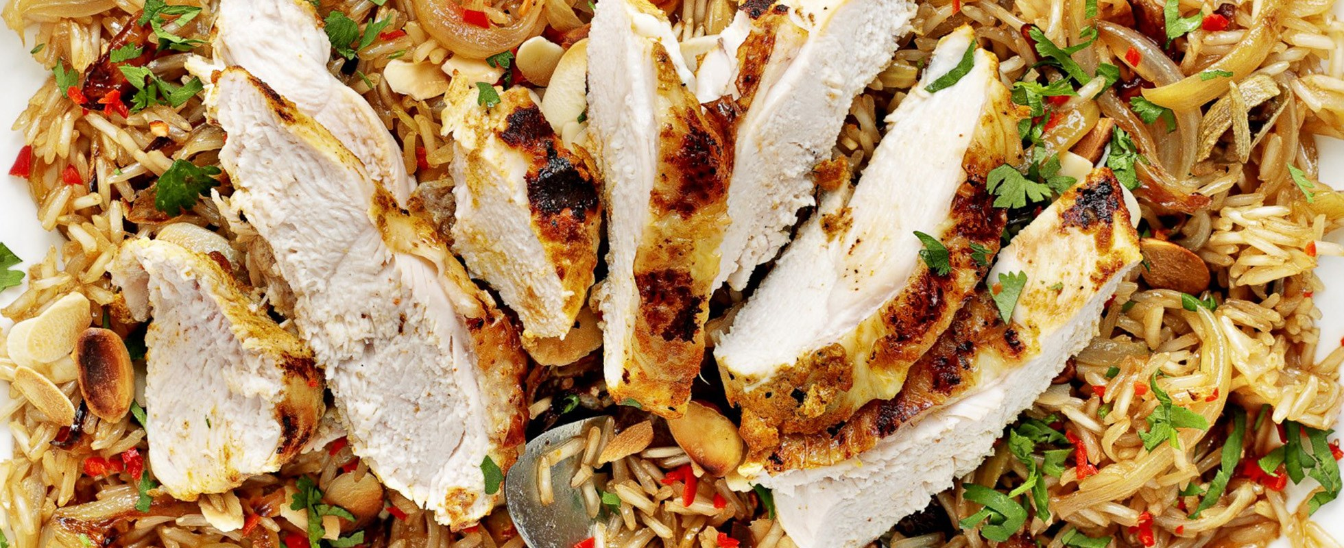 Yoghurt-spiced chicken with almond and coriander rice