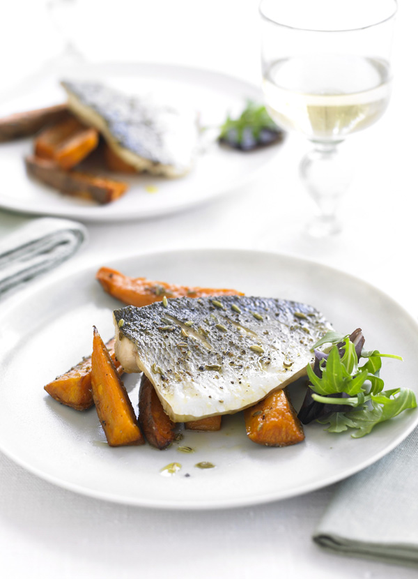 Seared sea bass with fennel seeds and roasted sweet potatoes