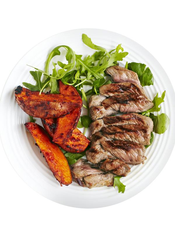 Lamb steaks with harissa-roasted sweet potatoes