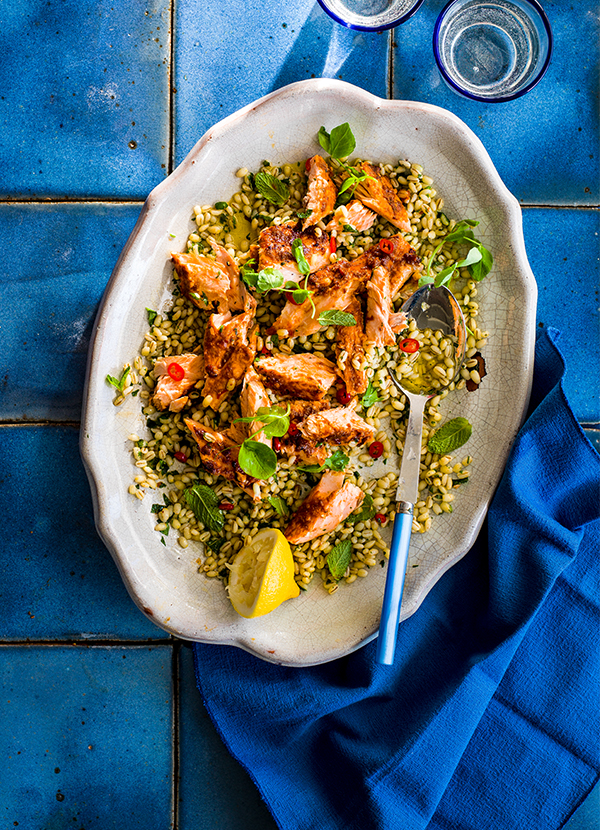 Salmon Salad Recipe With Chilli and Mint Dressing served in a white oval dish on a electric blue table cloth