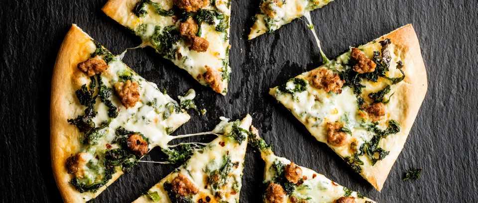 Smoky sausage and kale pizza