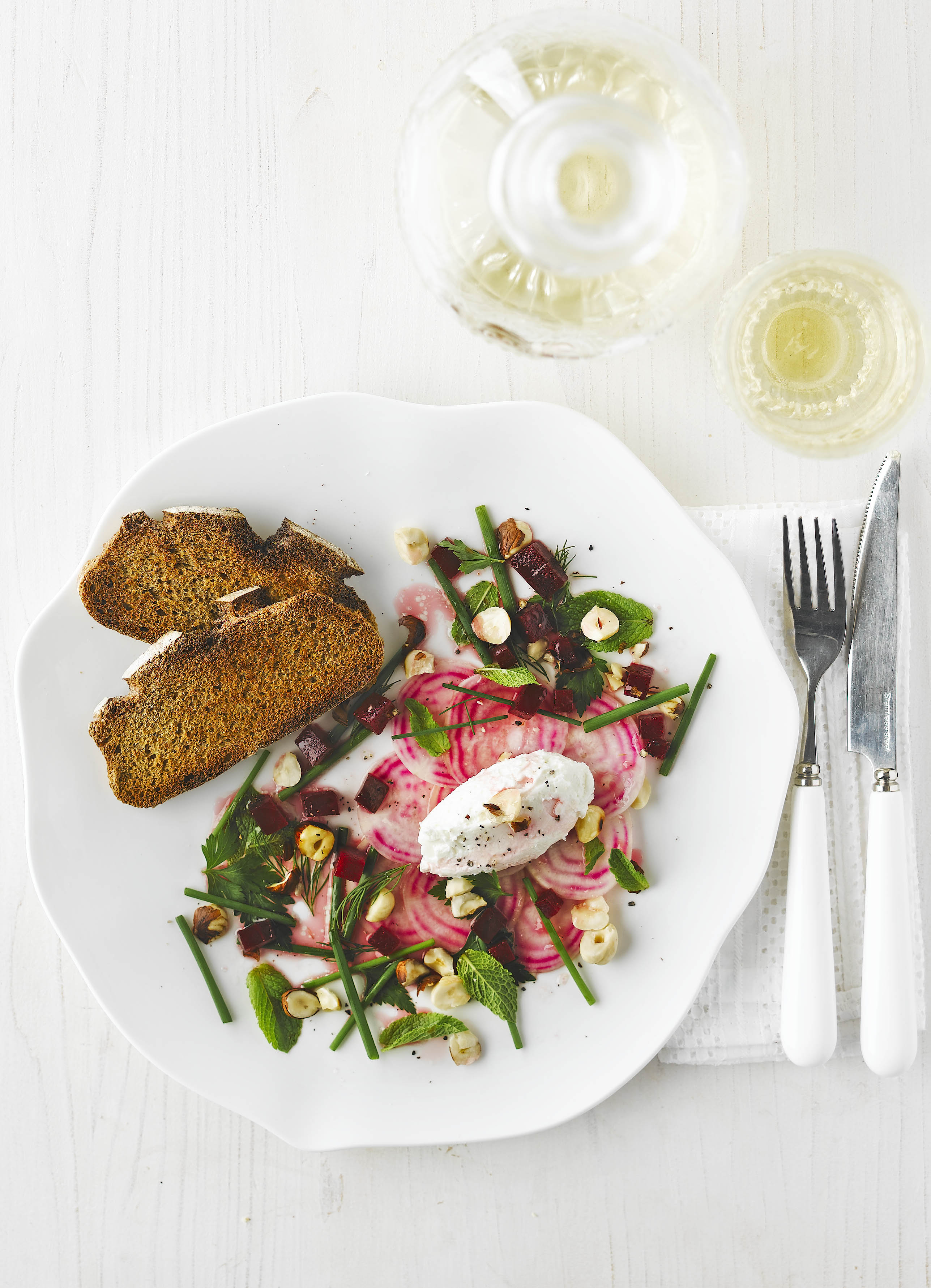 Whipped Goat's Cheese Recipe with Beetroot and Herb Salad served on a white plate