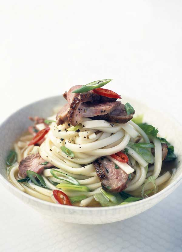 Hot and sour duck noodle soup with baby pak choy and noodles
