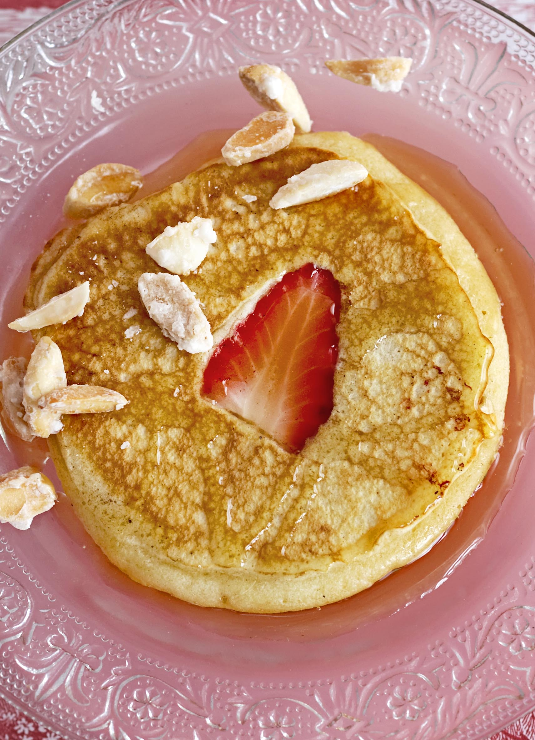 Strawberry pancakes with amaretto syrup and sugared almonds