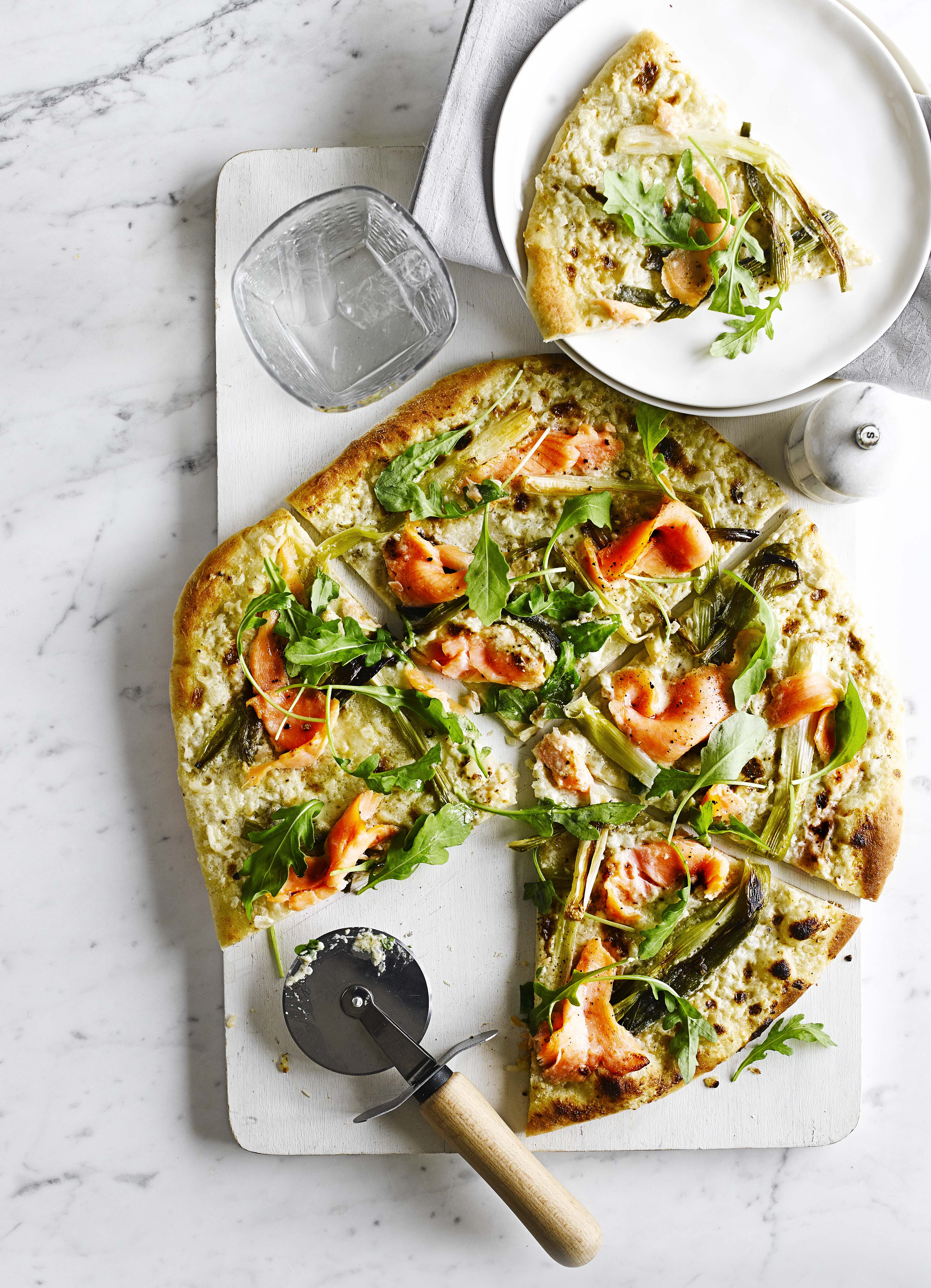Pizza bianca with smoked salmon and spring onions