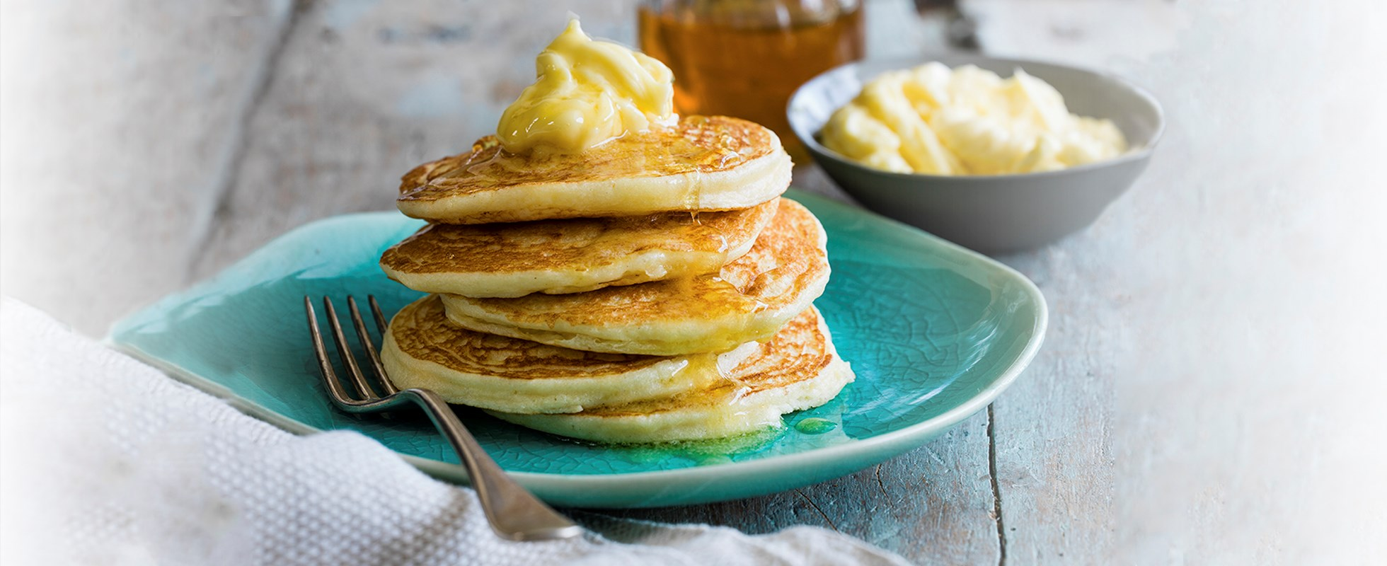 Fluffy ricotta pancakes with whipped honey butter