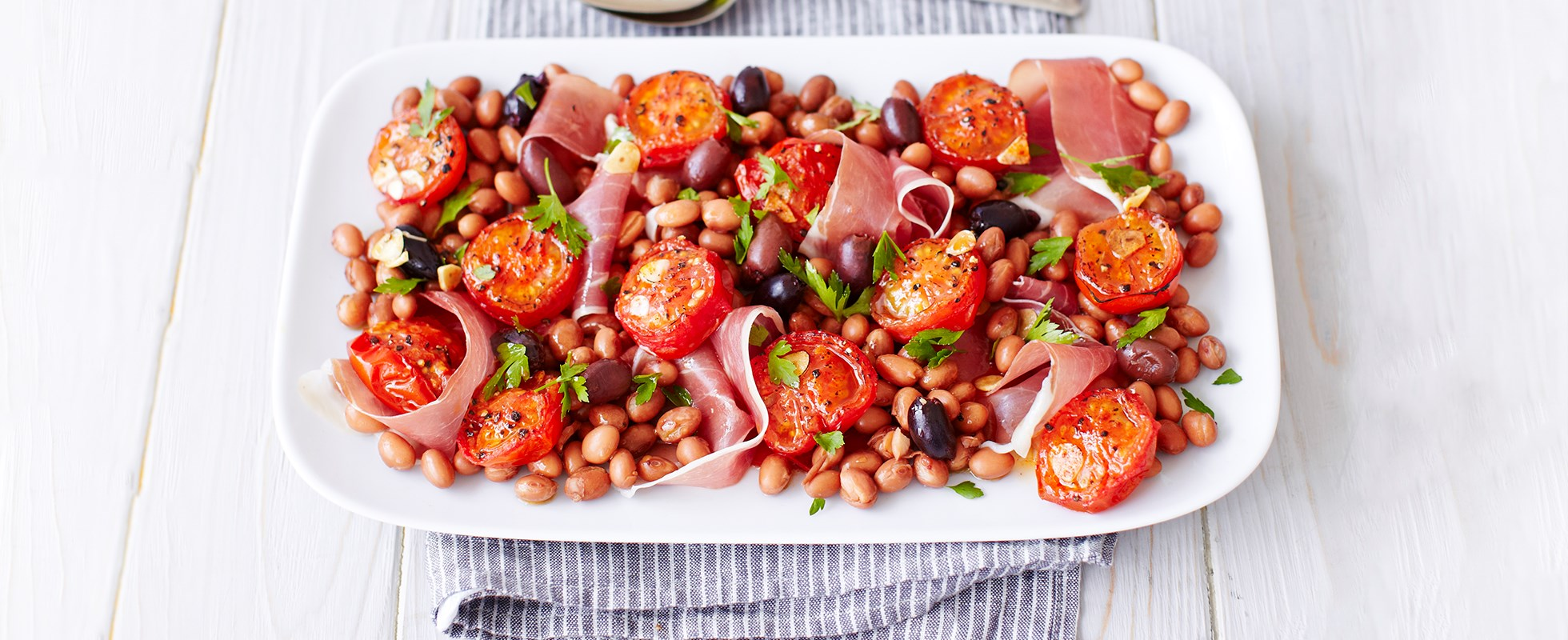 Prosciutto, borlotti and roast tomato salad