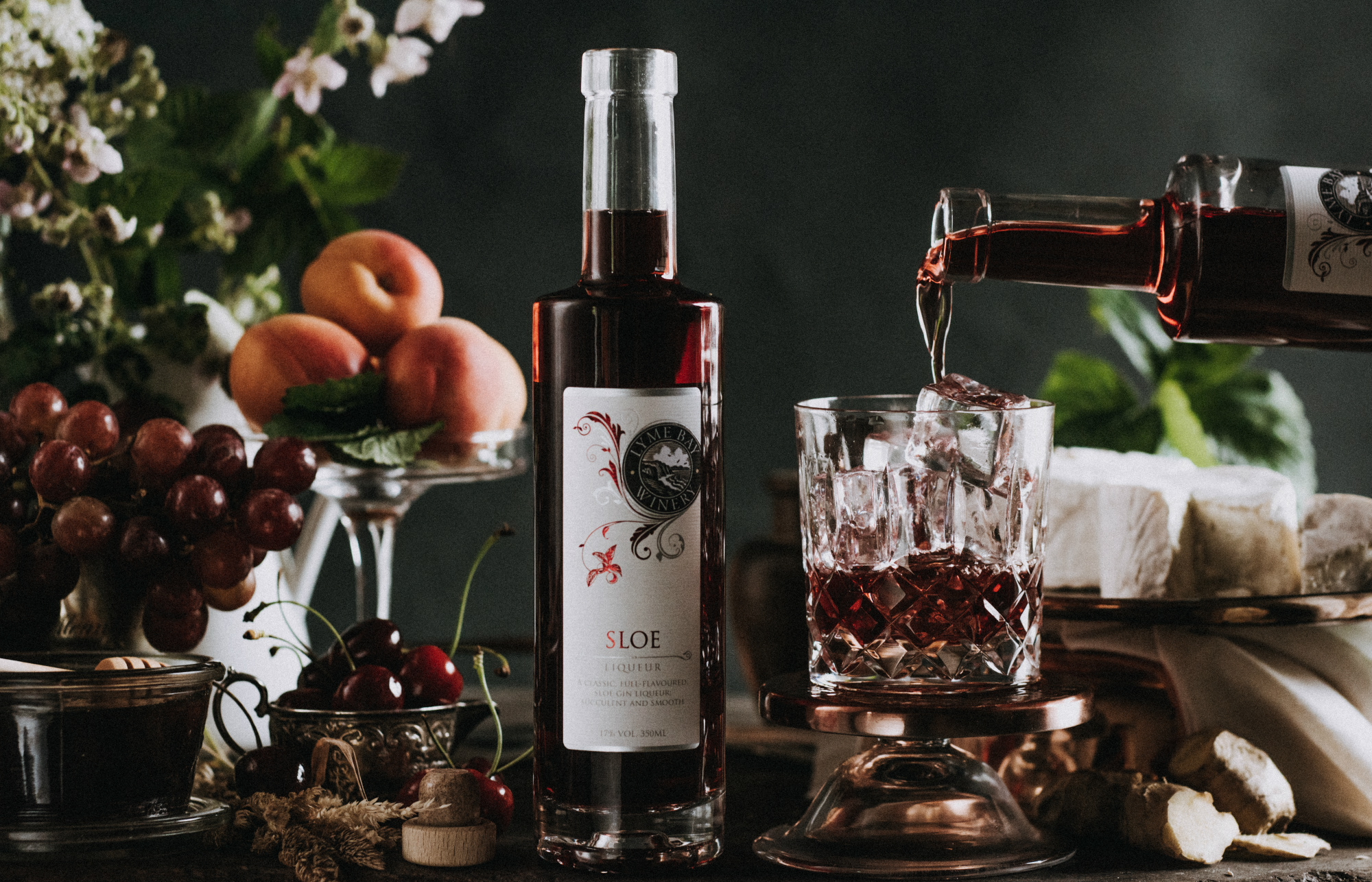 Lyme Bay winery sloe gin bottle with a glass of the gin being poured