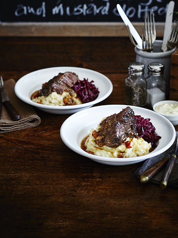 Spitfire-braised ox cheek with mash, red cabbage and English mustard clotted cream