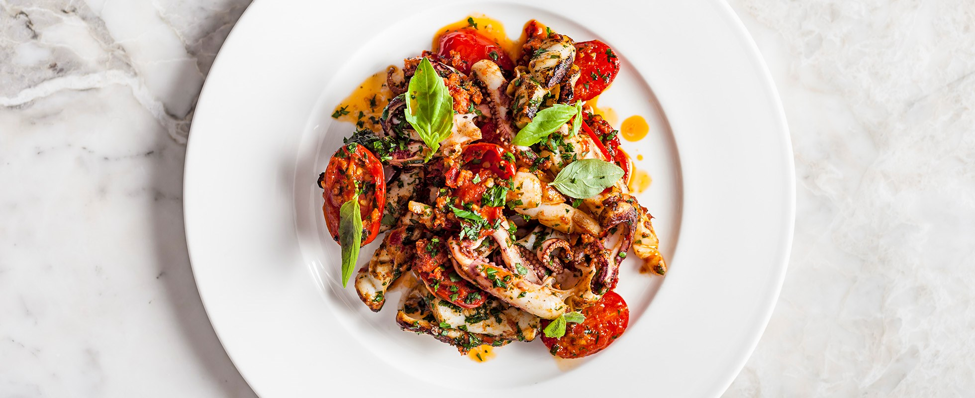 Charred squid with tomatoes