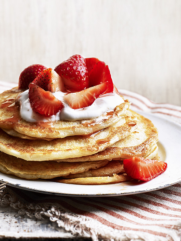 coconut pancakes with strawberries and lime syrup