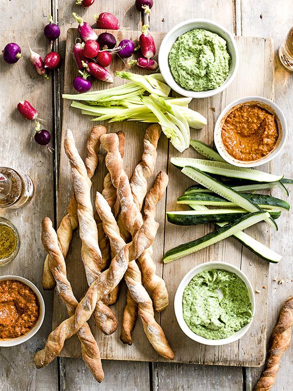 Green goddess and red devil dips with homemade breadsticks and veg