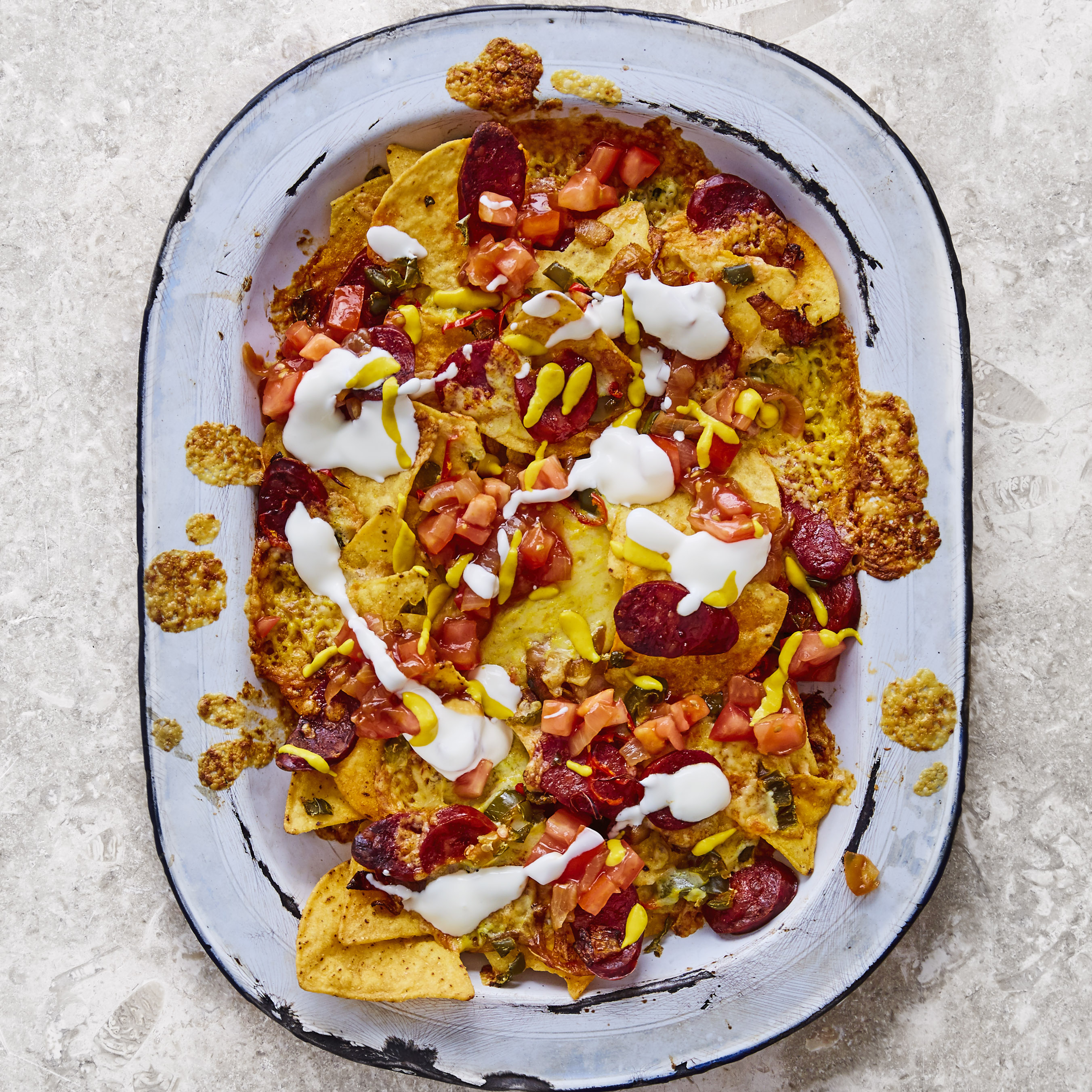 Caramelised onion and chorizo nachos