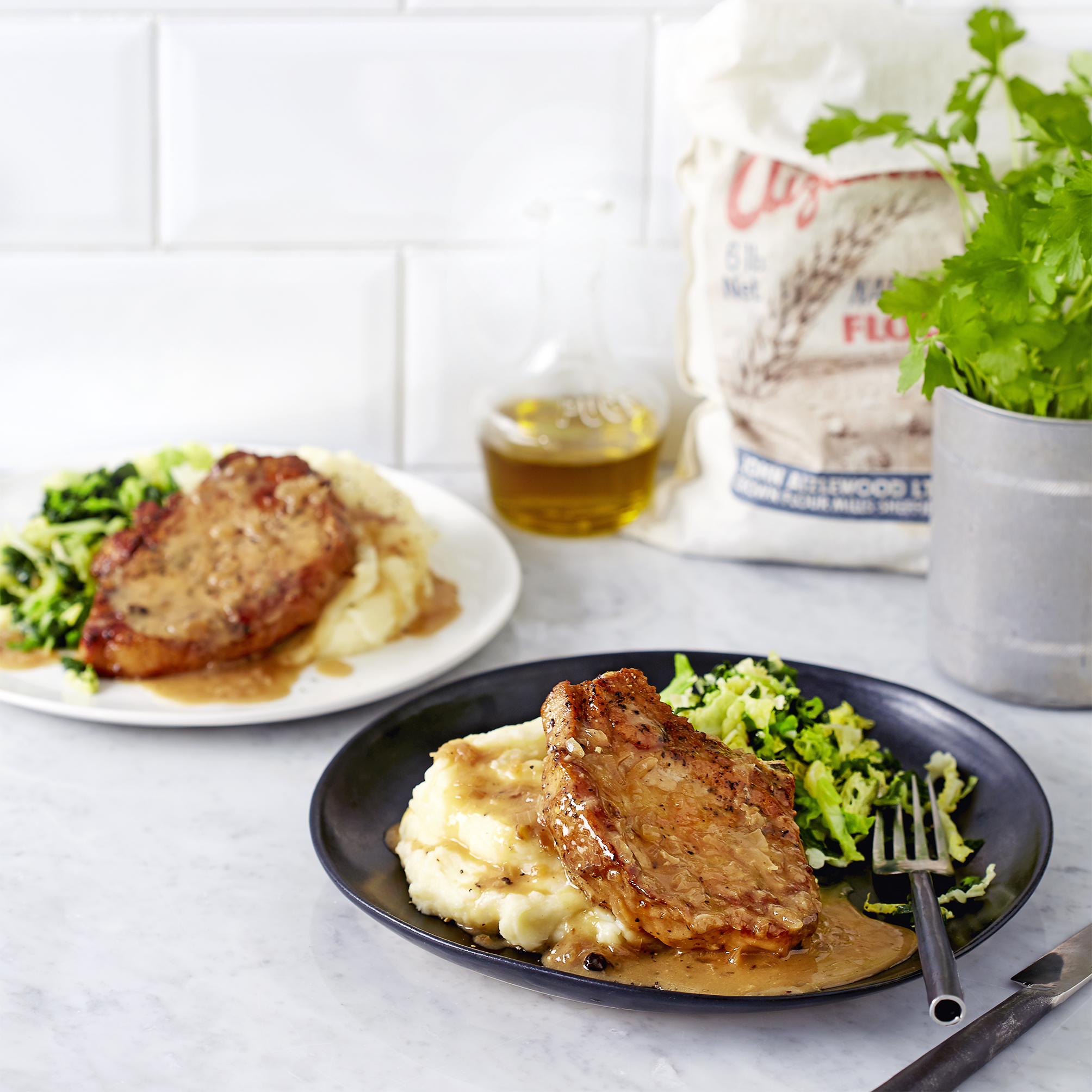 Pork chops in cider and juniper with creamy mash