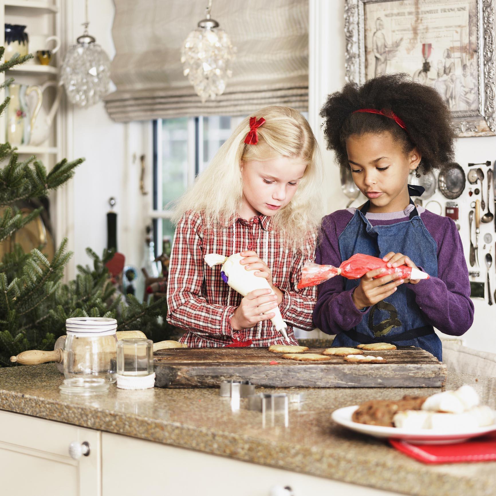 Girls baking Christmas cookies