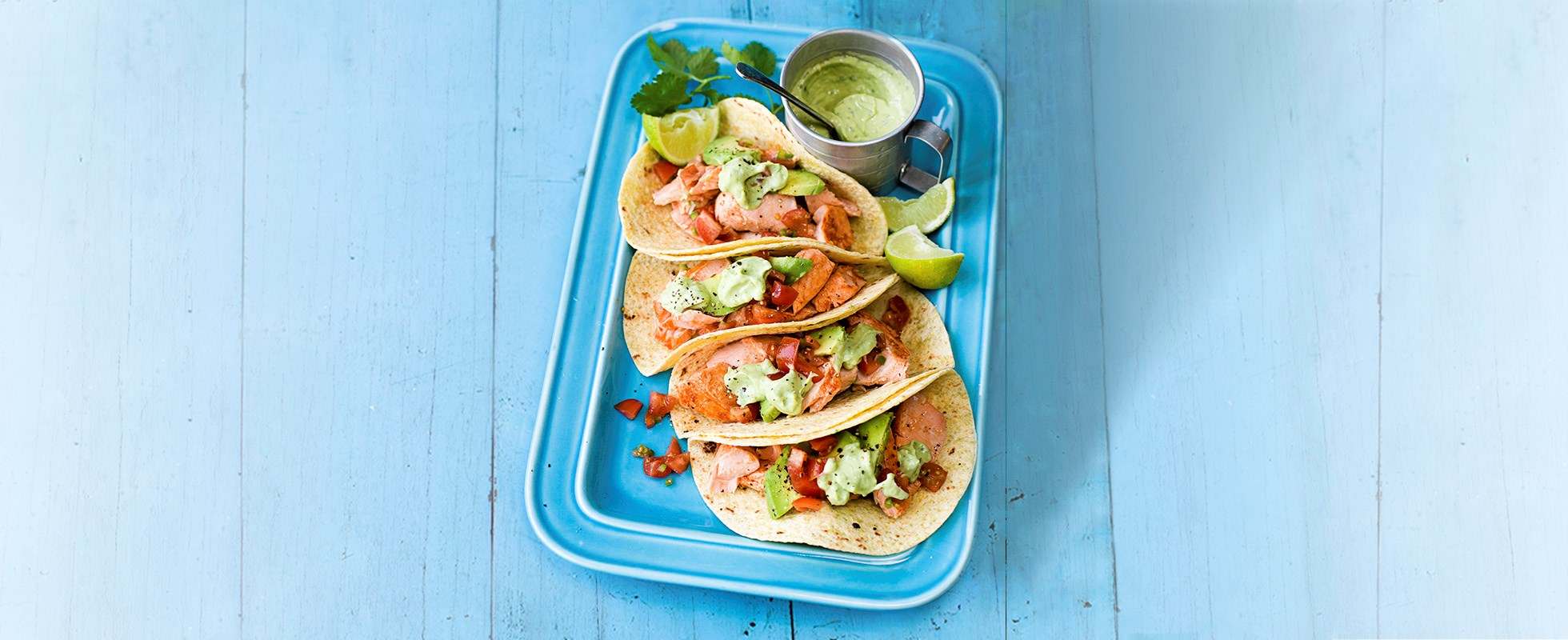 Lime grilled salmon tacos with avocado cream