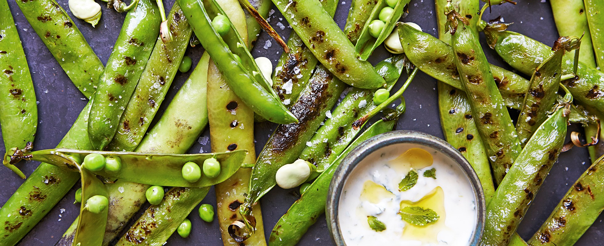 Grilled peas and broad beans with minted yogurt sauce
