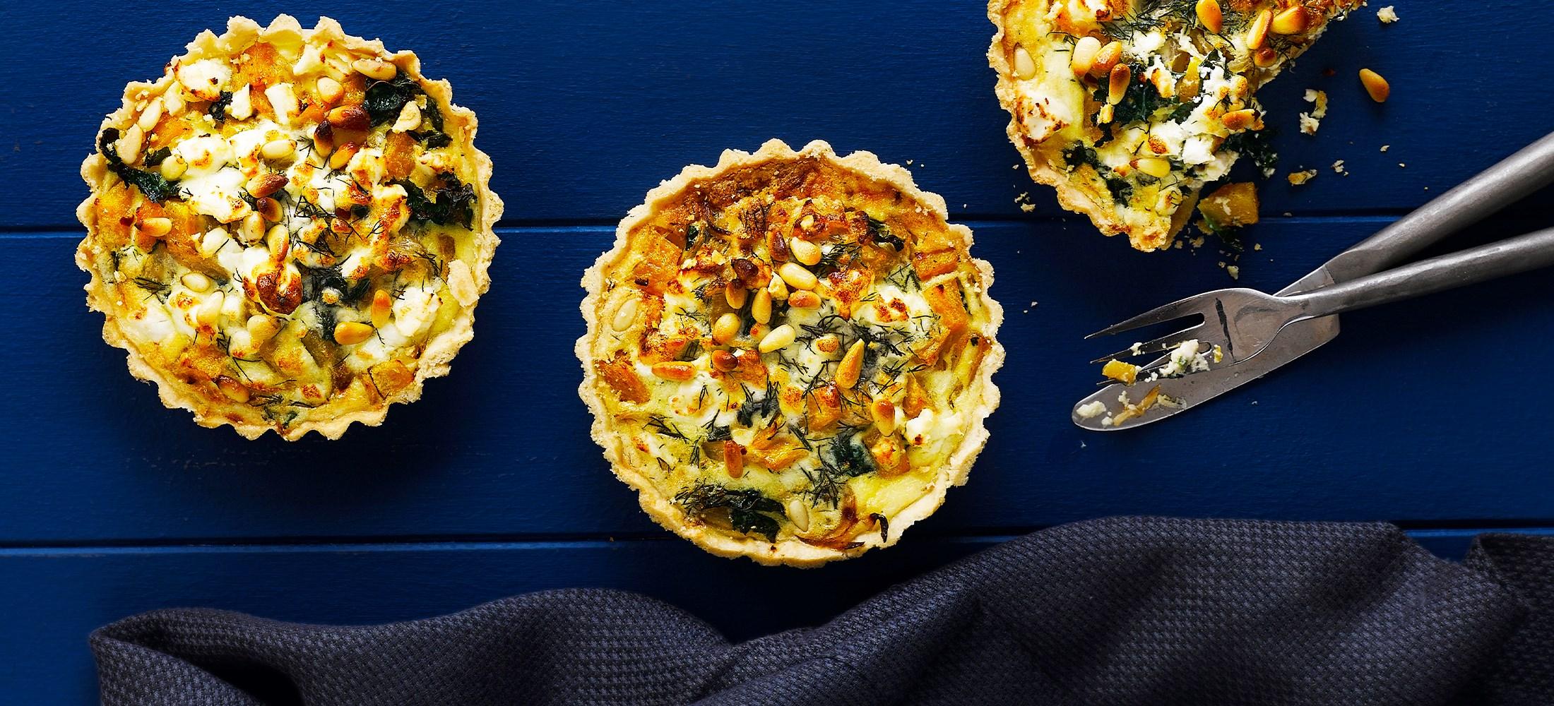 Squash, kale, caramelised onion & feta tarts
