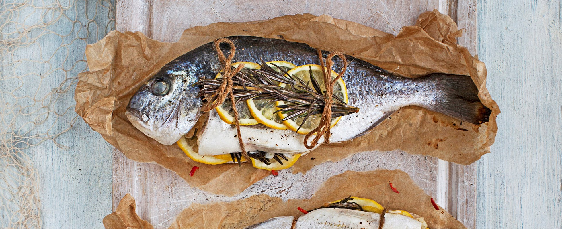 Whole sea bream cooked en papillote