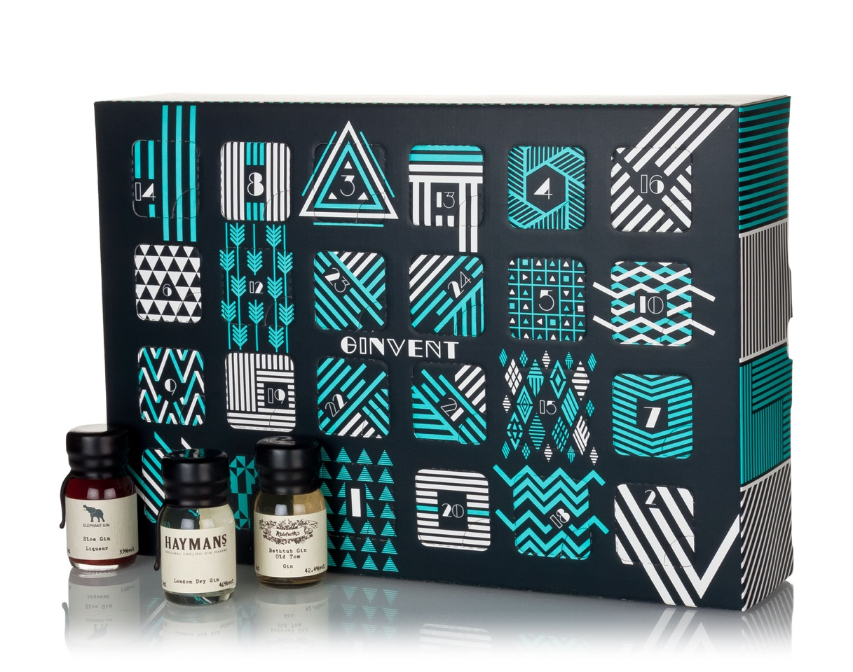 Ginvent advent calendar. A dark blue box has blue and white designs on each door. There are three mini bottles outside of the calendar