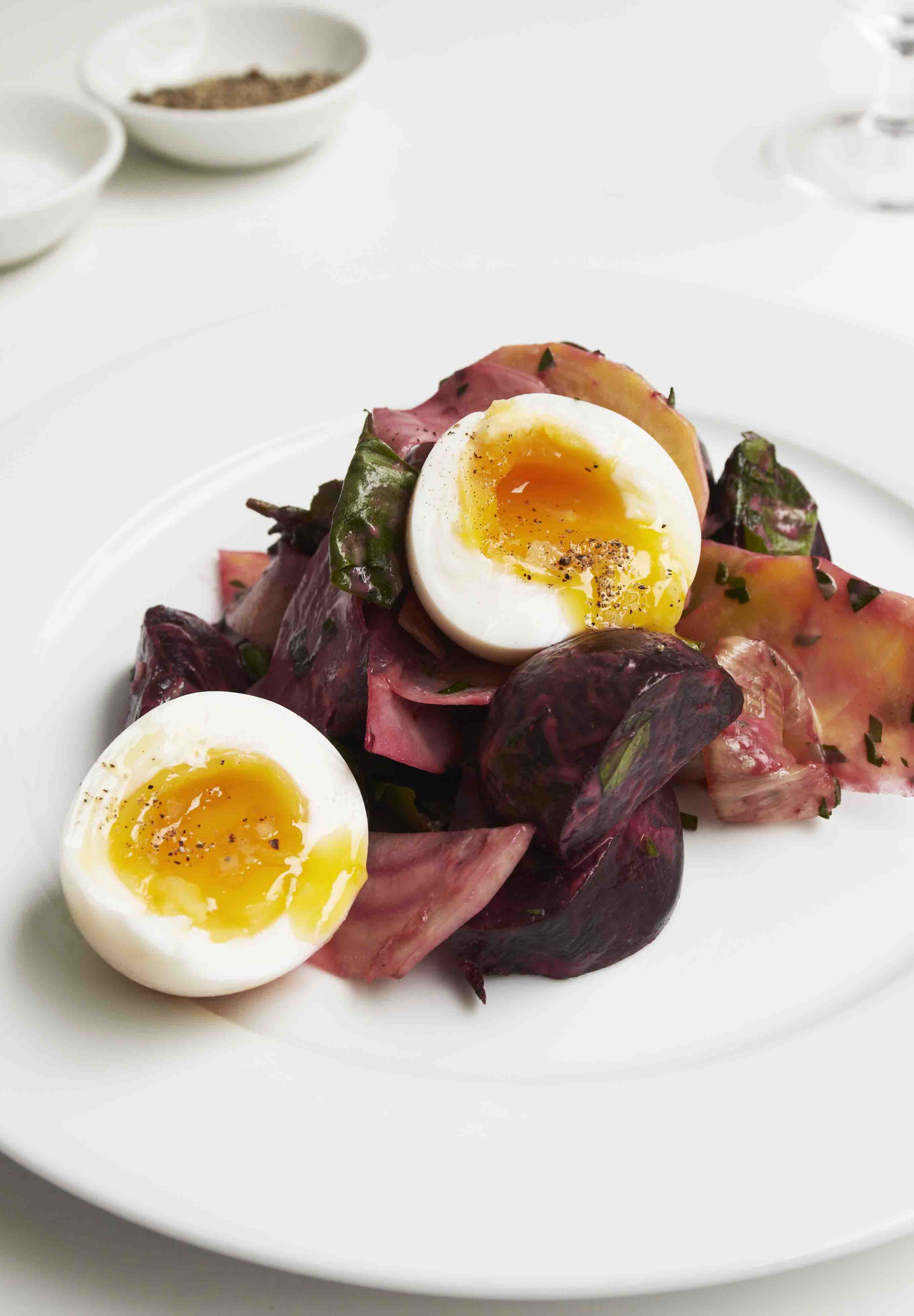 Beetroot salad with poached eggs on top