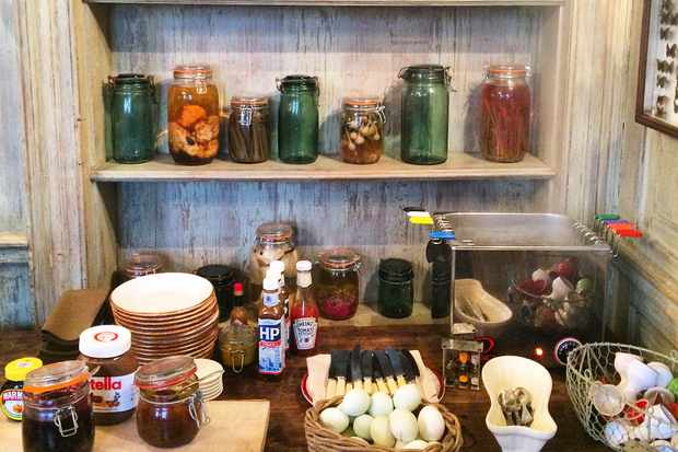 Breakfast items with eggs and spreads and coloured glass jars
