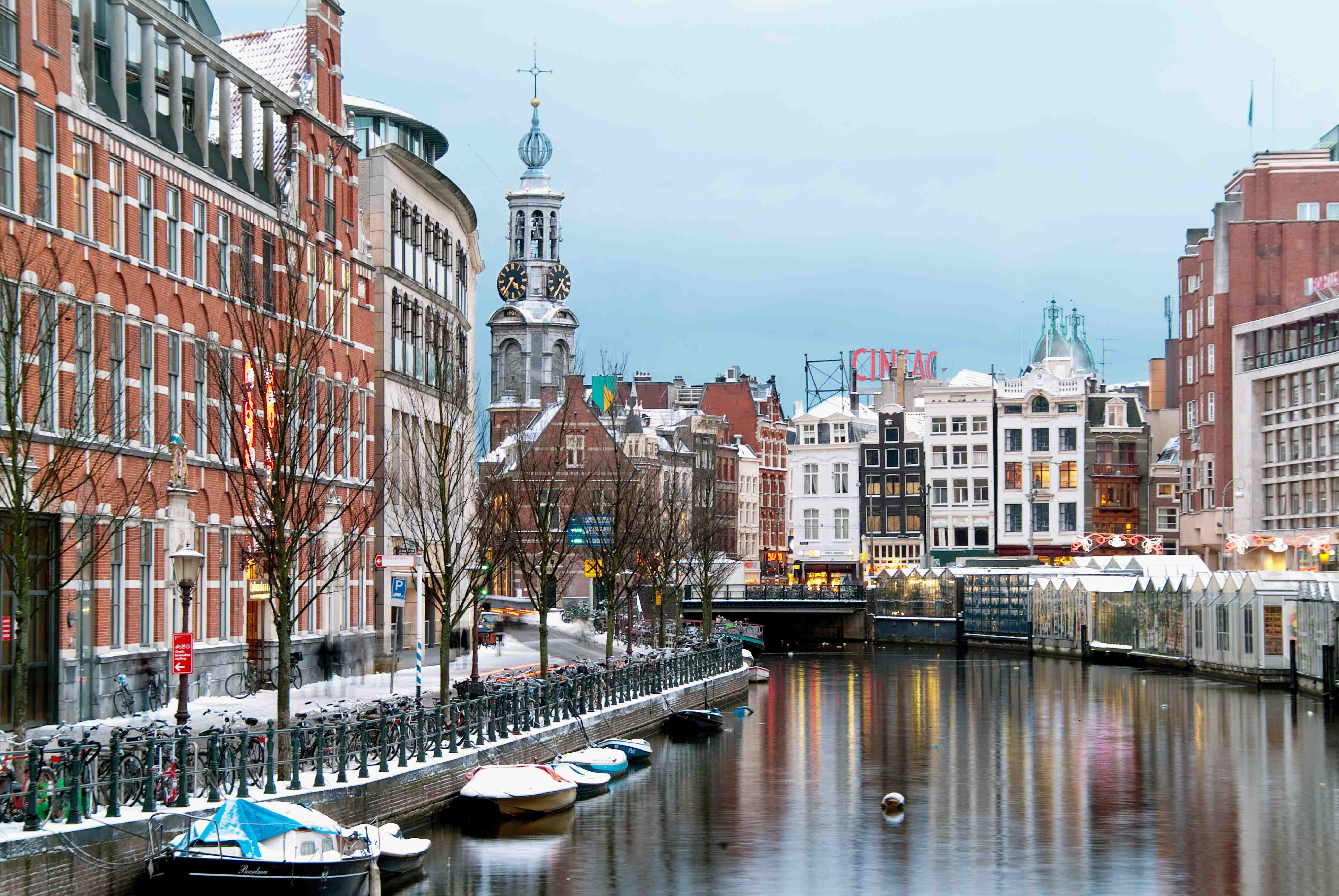 Amsterdam's buildings and canal in winter