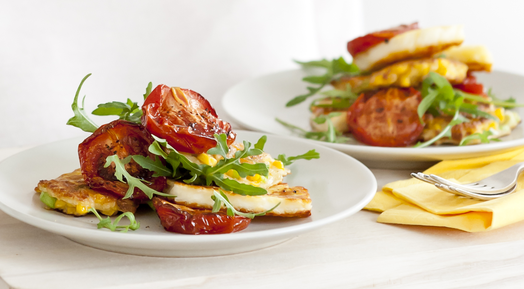 Sweetcorn fritters with roasted tomatoes and halloumi