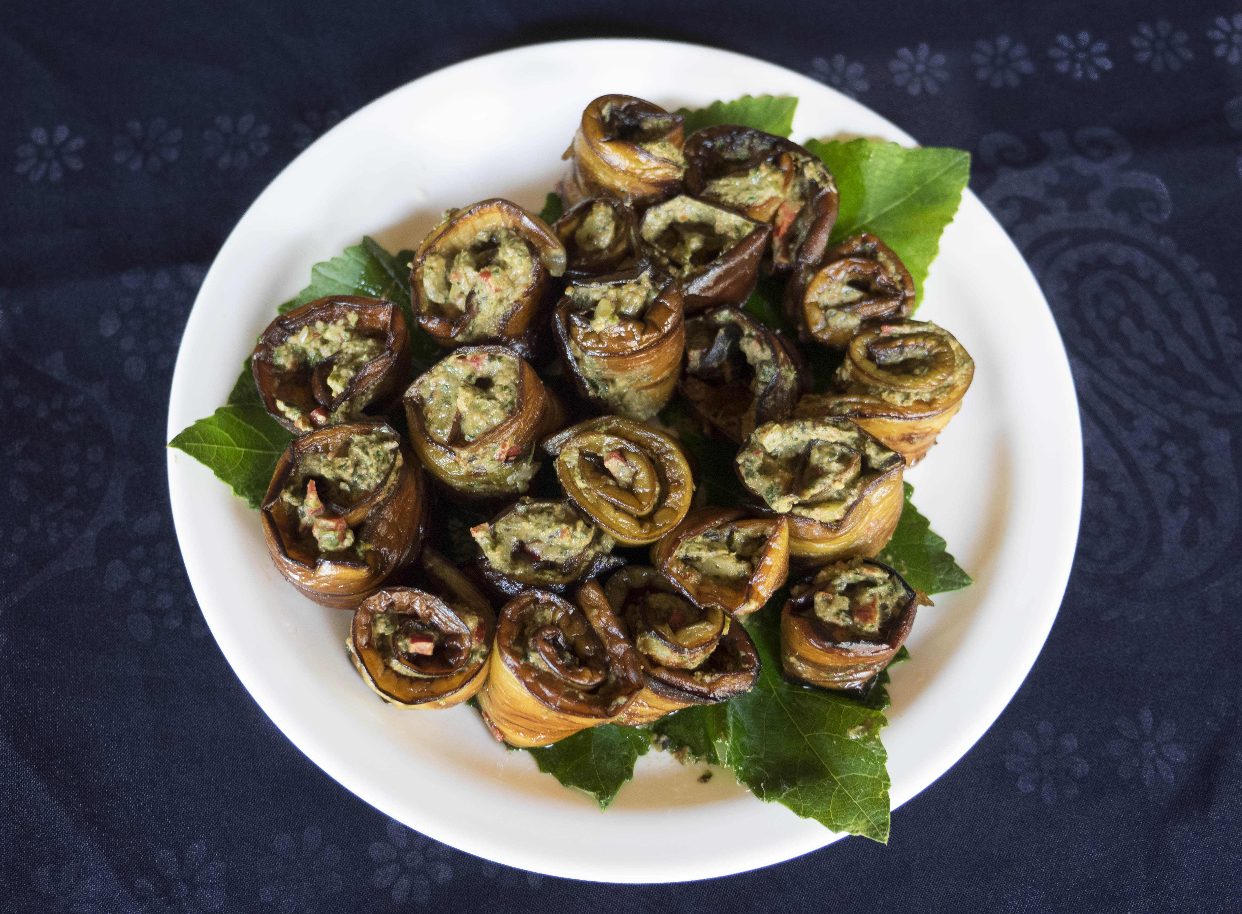 Fried aubergines stuffed with walnut and herb paste