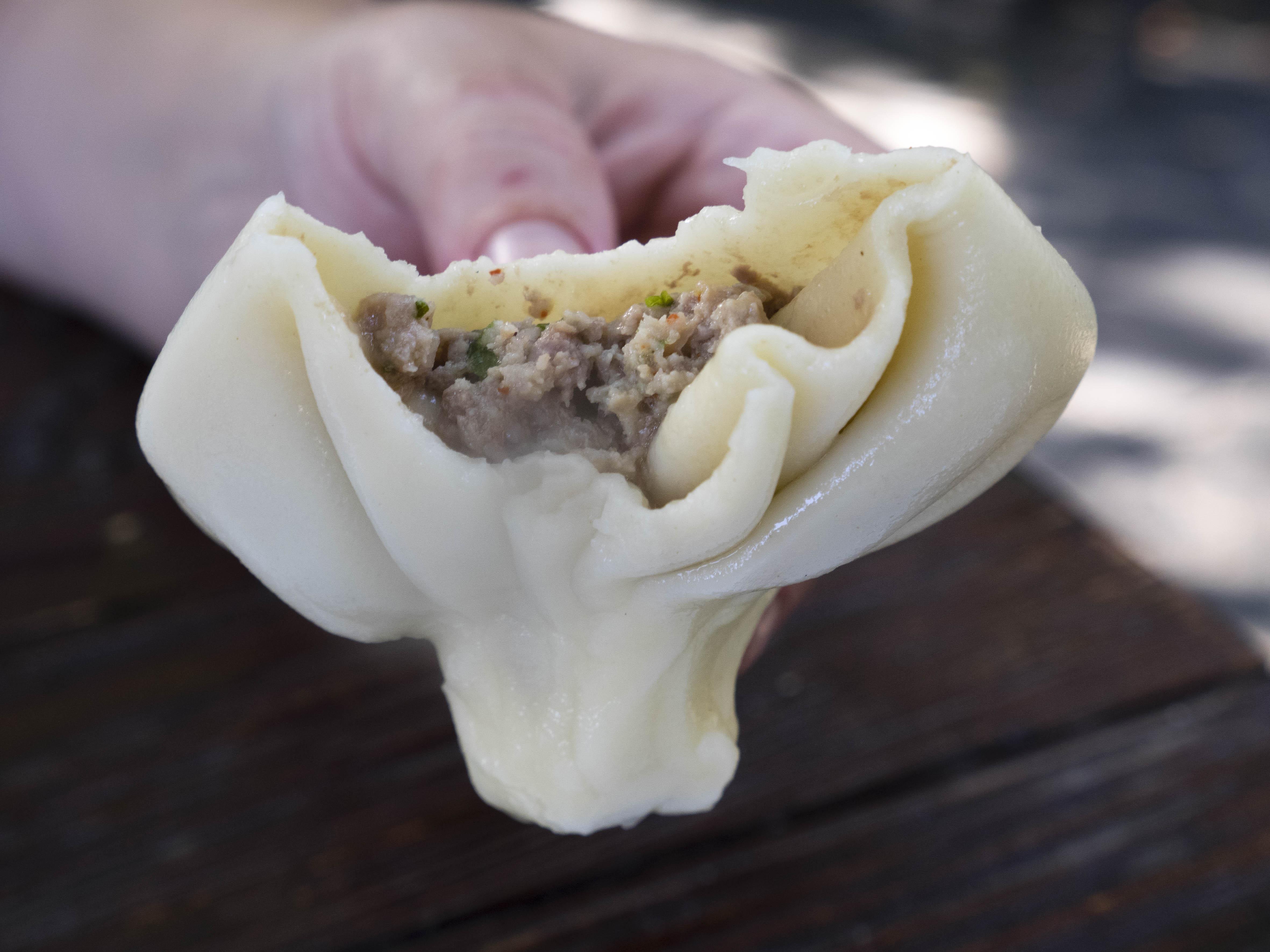 A large meat-filled khinkali dumpling