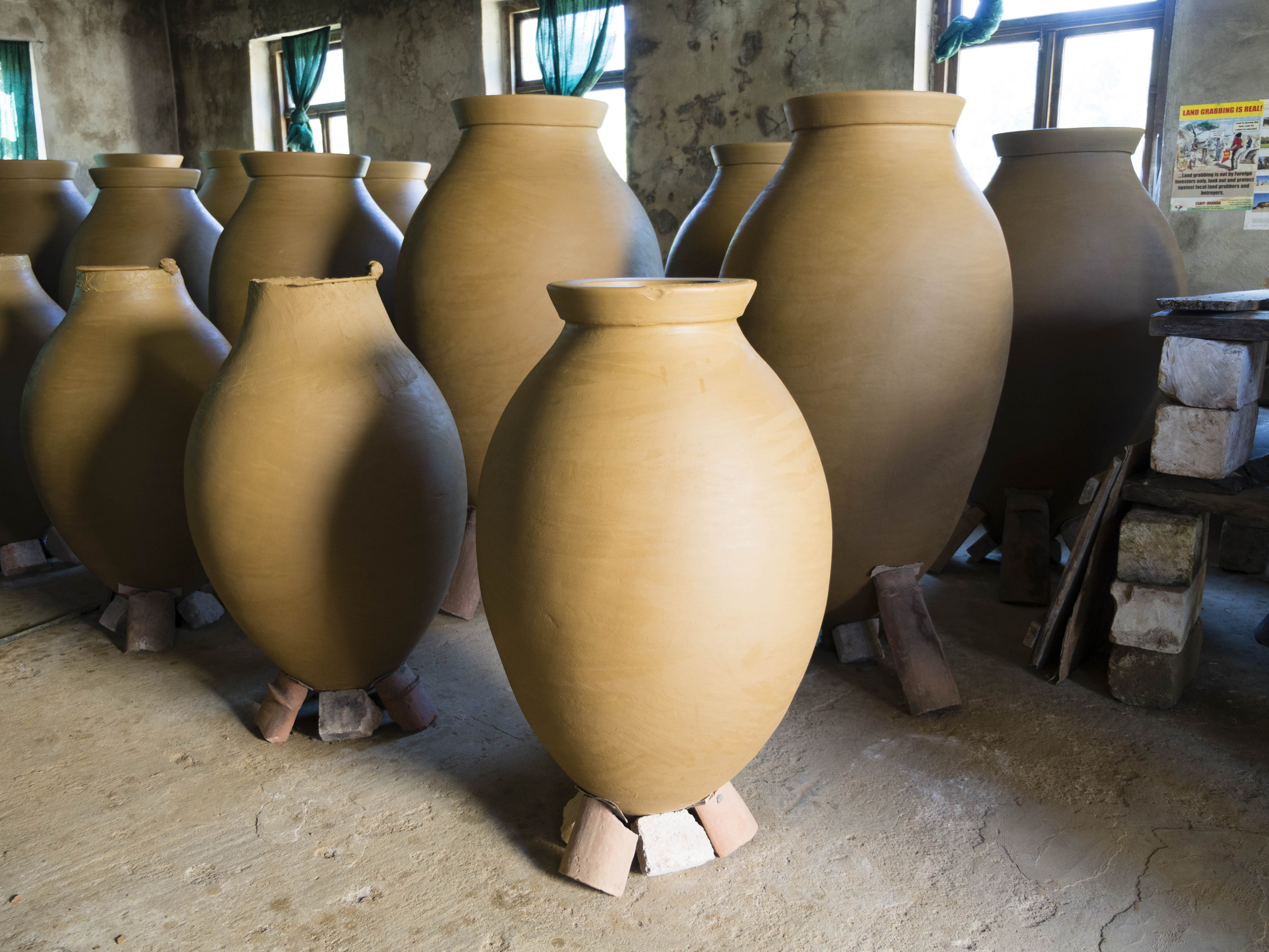 Clay qvevri being finished in the potter's studio