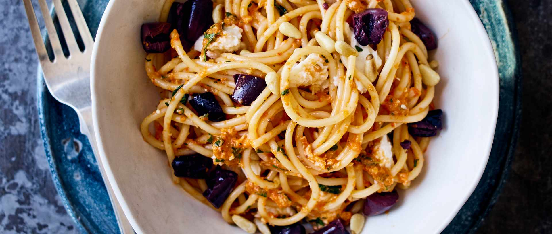 Spaghetti with ajvar, mozzarella and smashed olives