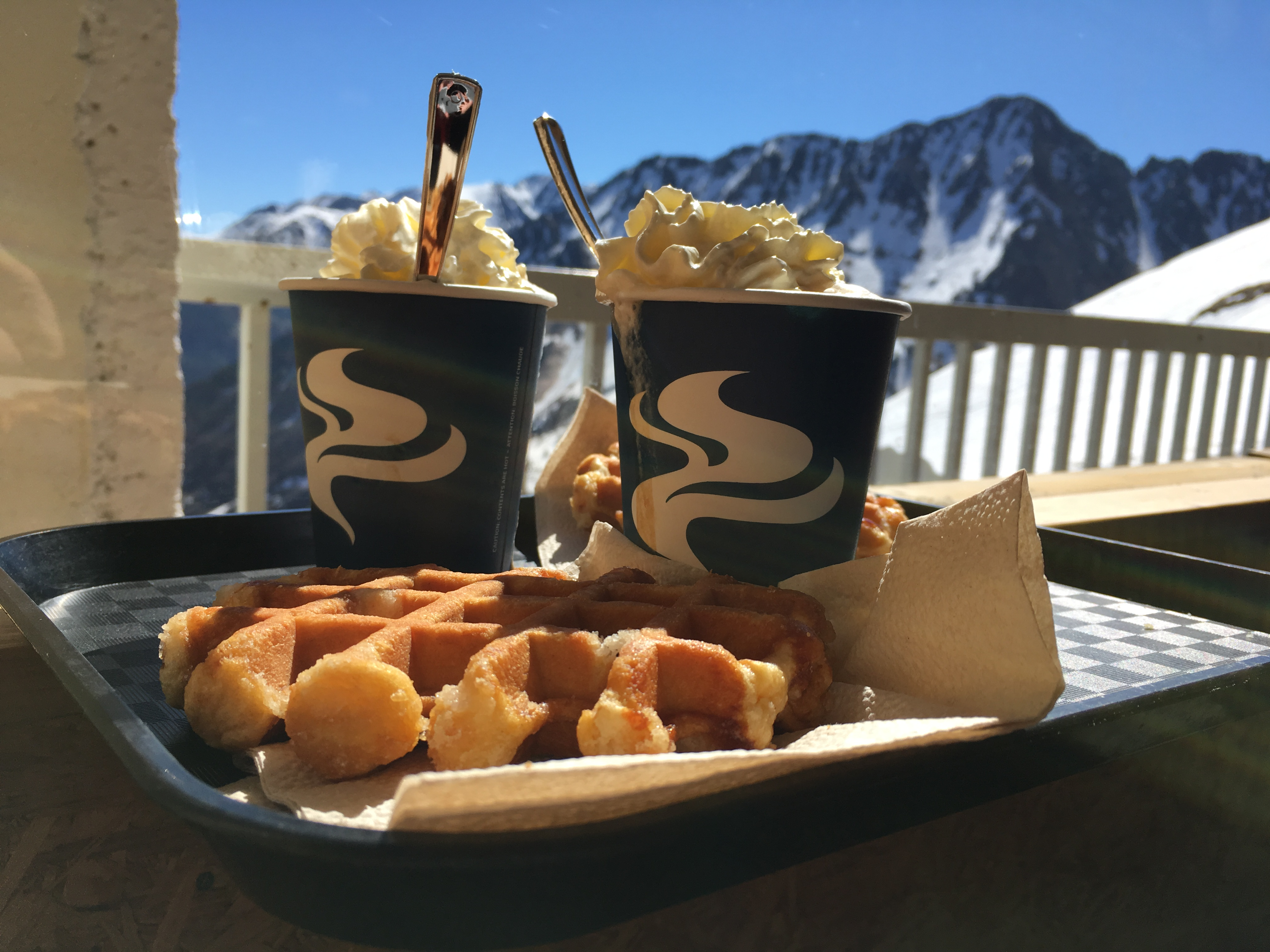 Waffles are cream topped hot chocolates in the snowy mountains