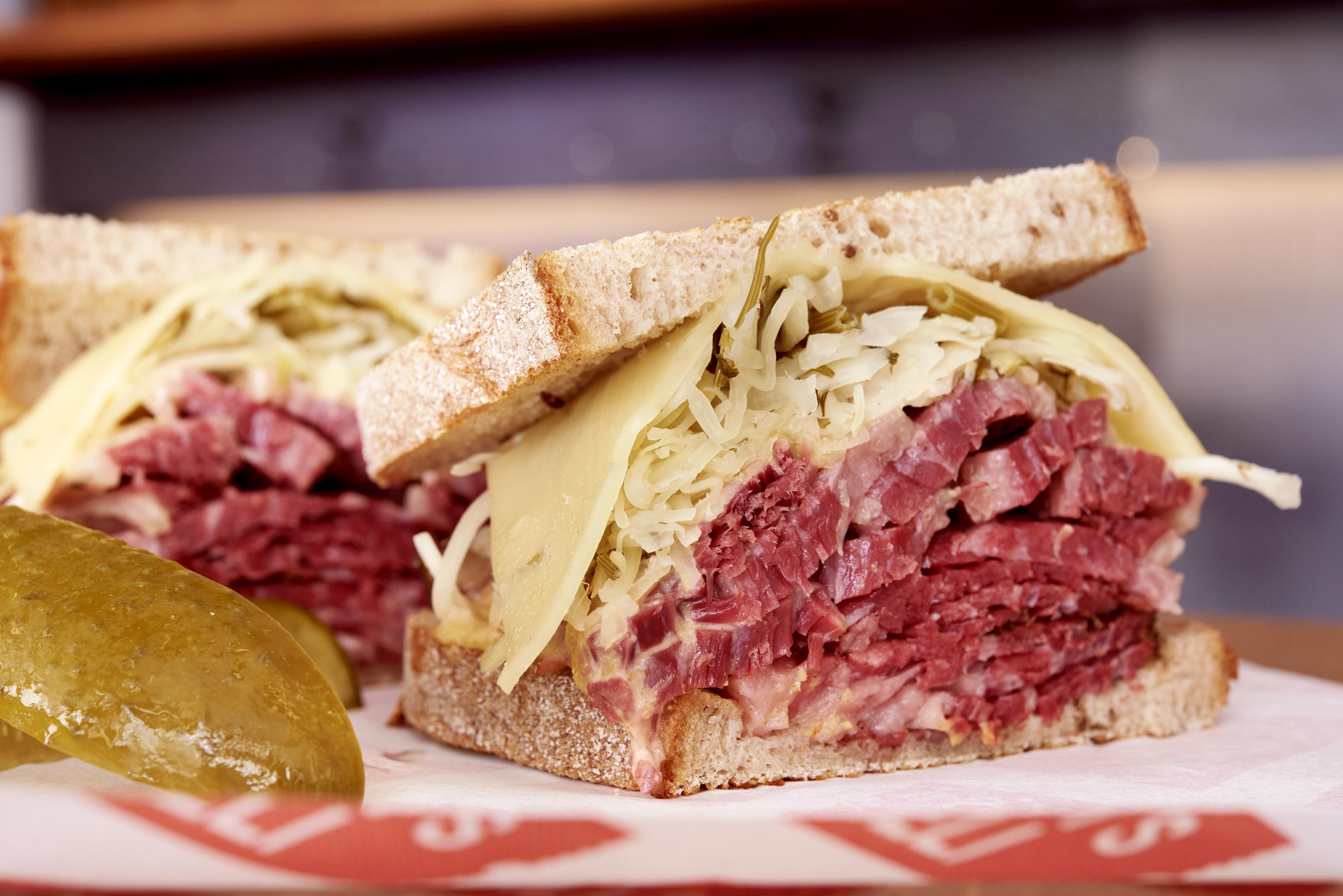 Monty's Deli salt beef sandwich with cheese and gherkin