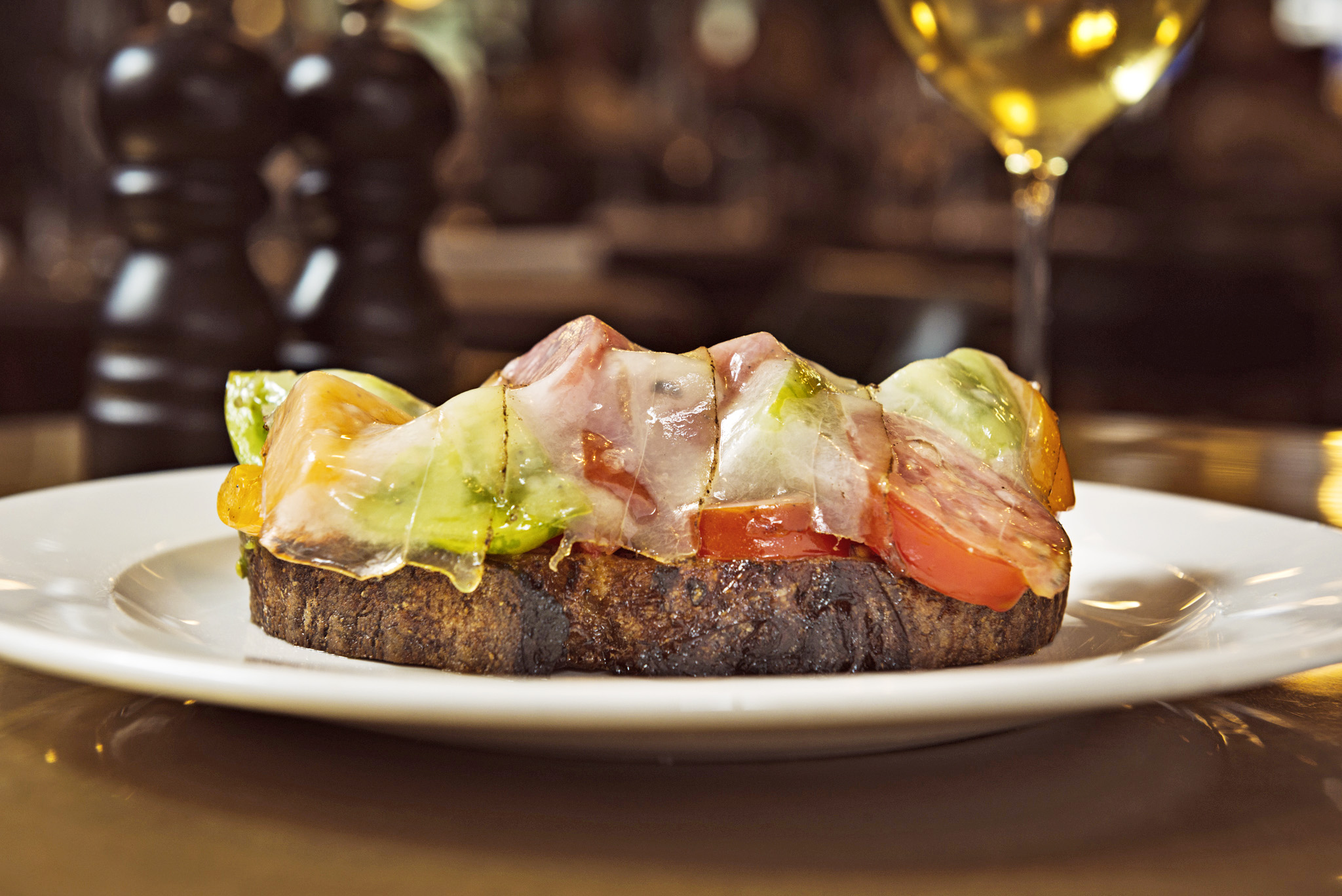 Hawksmoor at Borough Market - Uses local cannon & Cannon to source Cornish Lardo with layers of roasted heritage tomatoes on toast