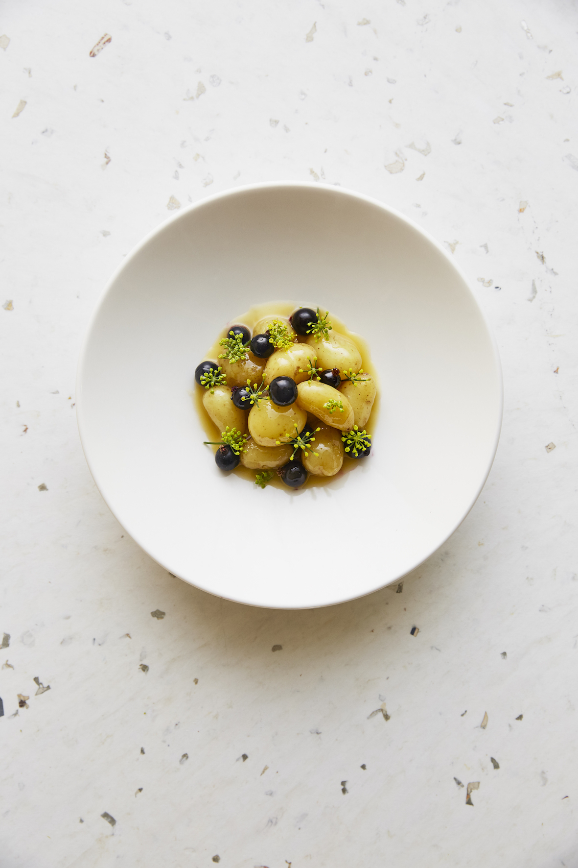 Cub London, Linzer potatoes, blackberries and fennel flower - served in a round white bowl