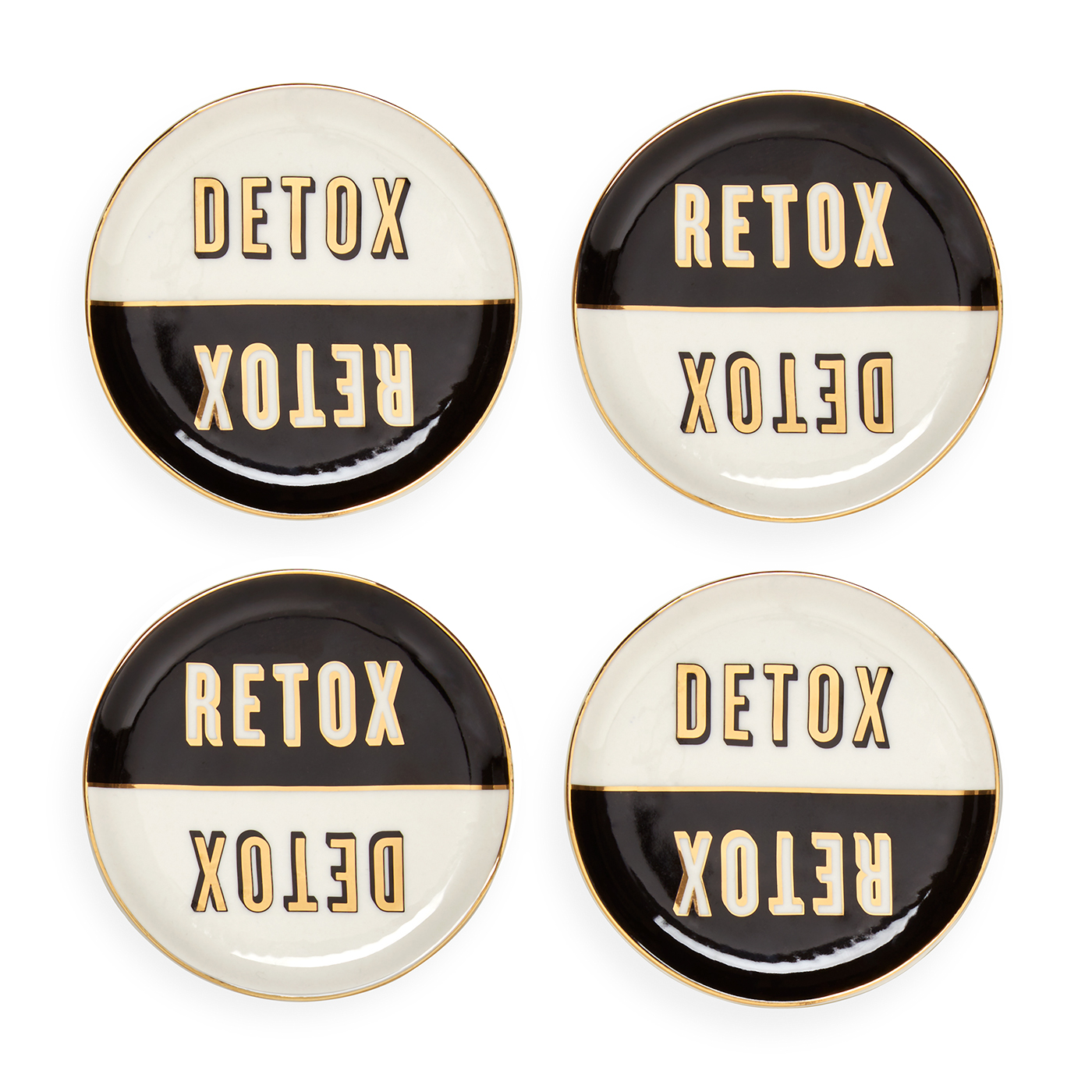 A set of four coasters in black and gold that say Retox and Detox on them