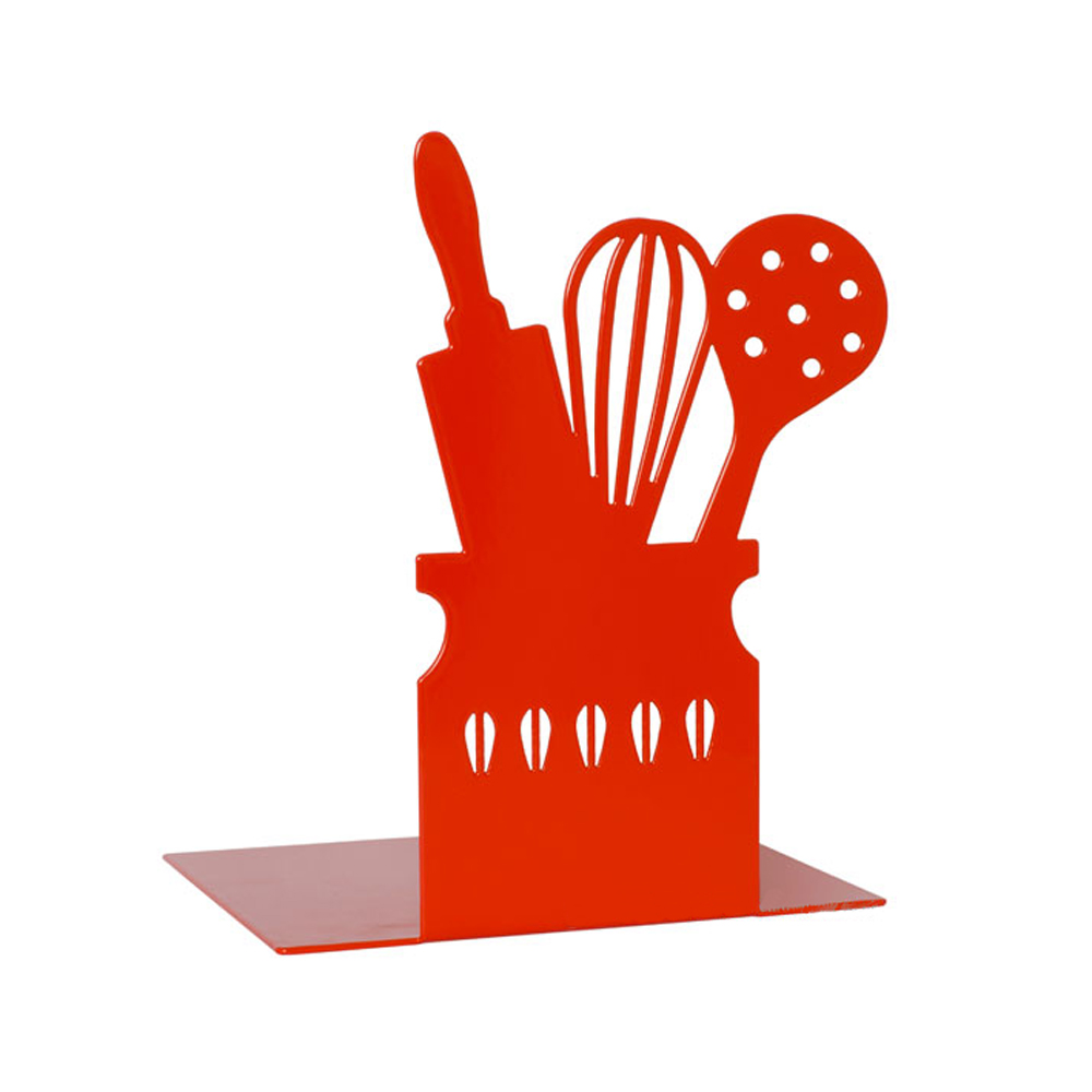 A vibrant red bookend with has a cut out of a rolling pin, whisk on spoon on it