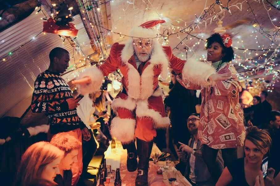 Father Christmas dancing on the table at Christmess