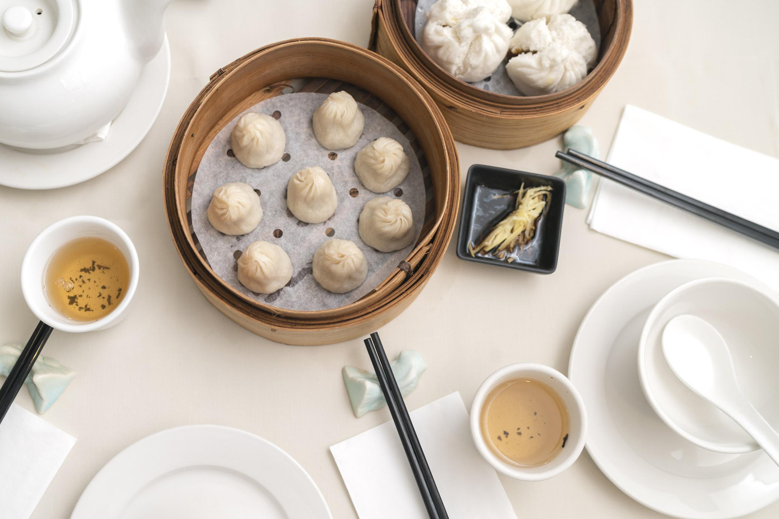 A bamboo steamer filled with dumplings at Dumplings Legend Chinatown London