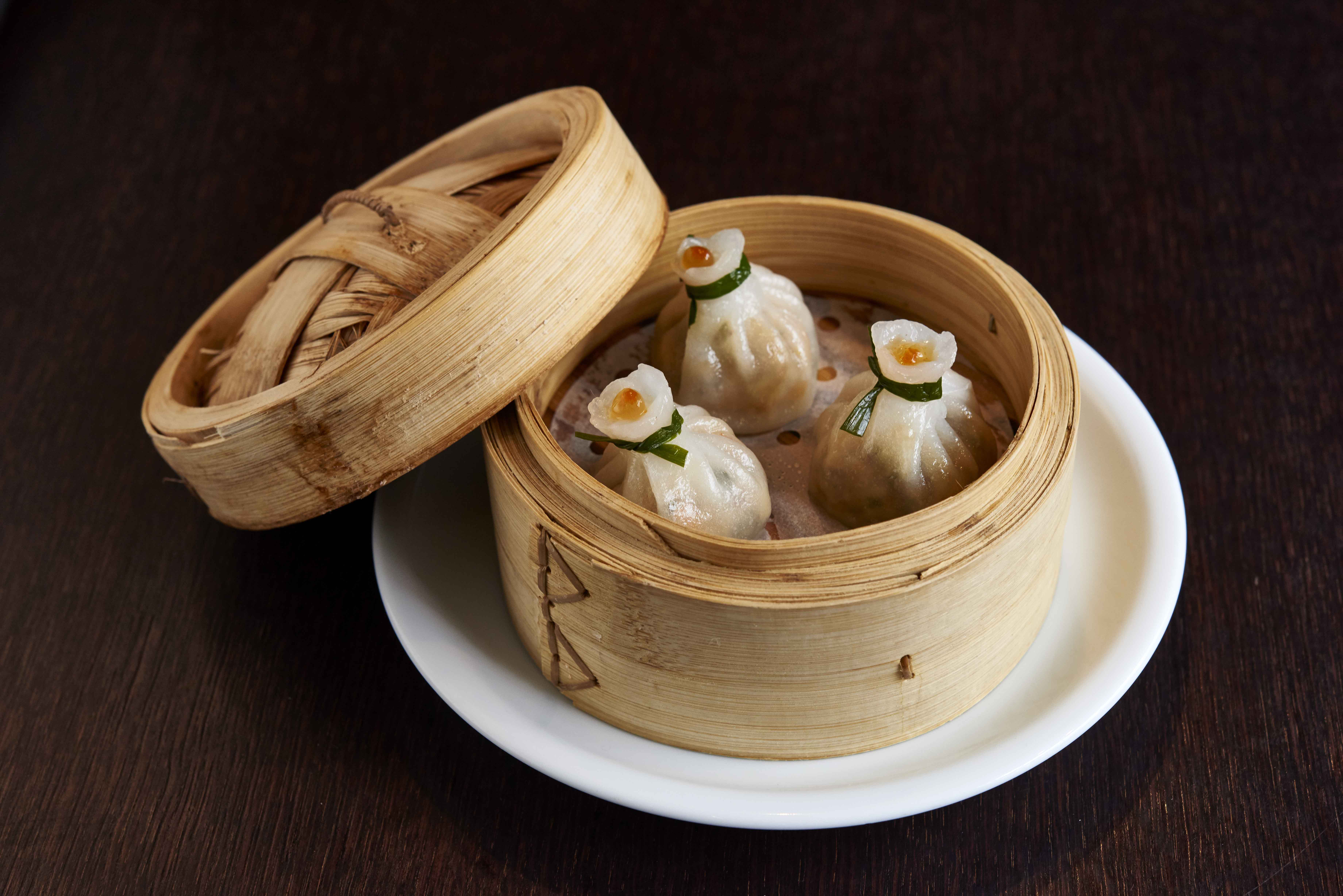A bamboo steamer filled with dumplings at PlumValley Chinatown London