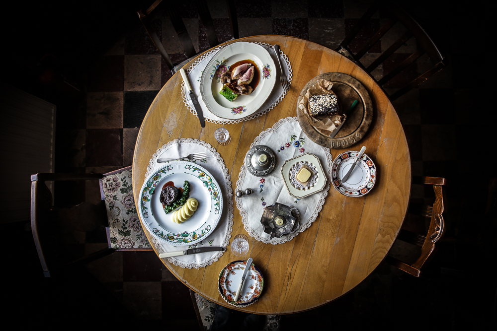 A table with three dishes of food on it it