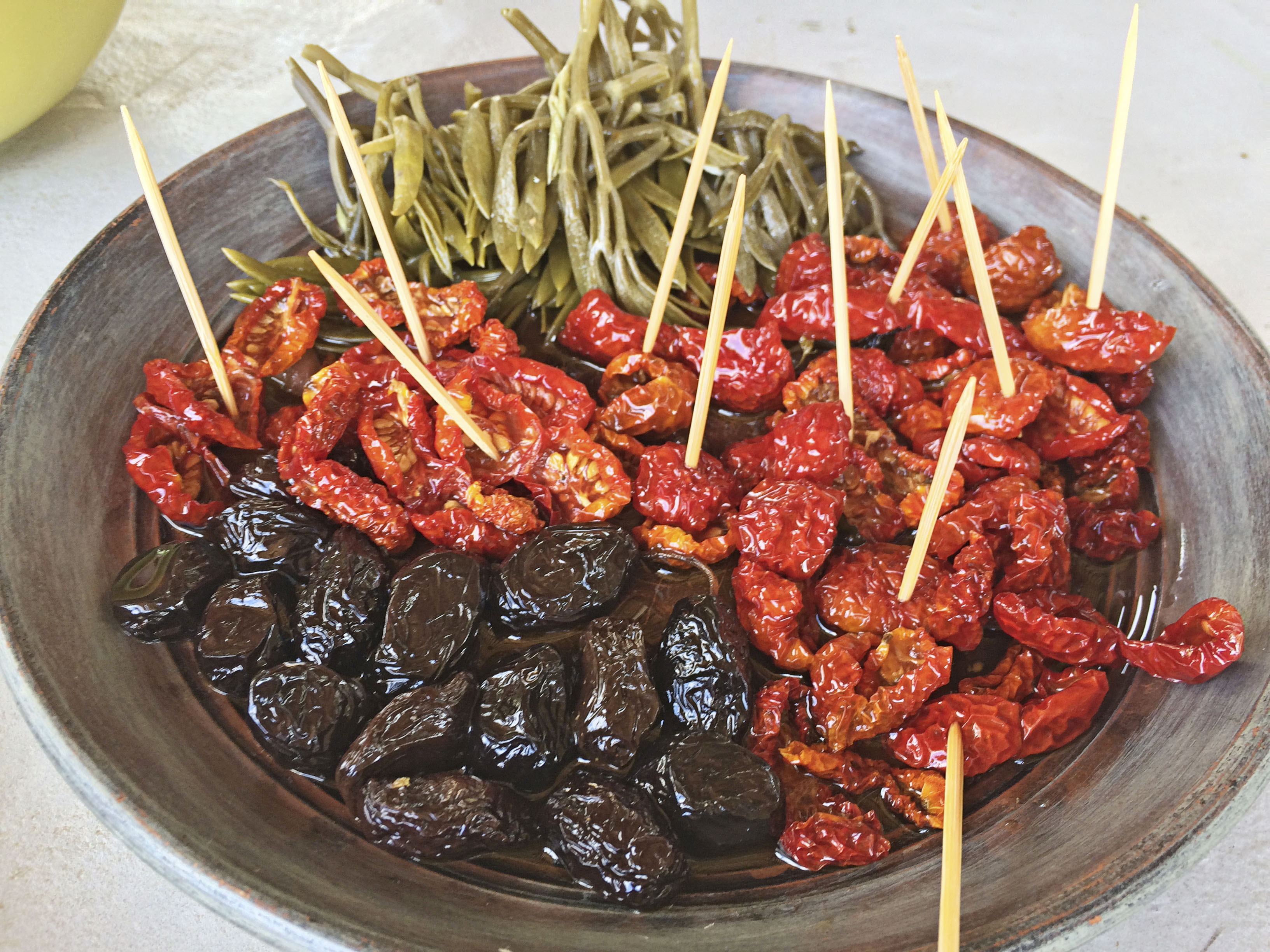 Olives and sundried tomatoes at hand picked Greece