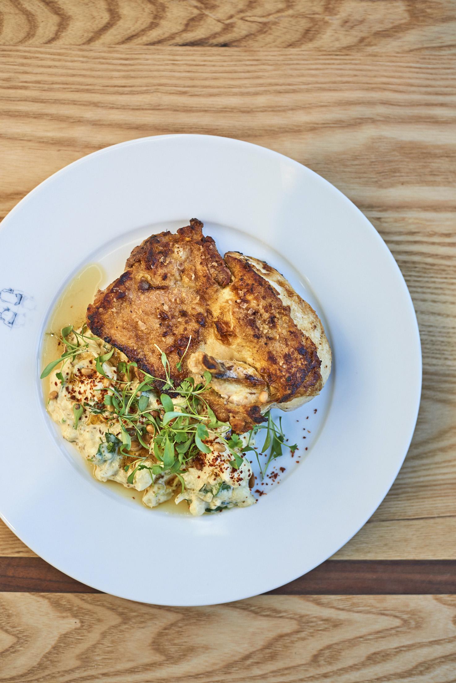Chicken and Cauliflower Recipe with Yogurt on a white dinner plate