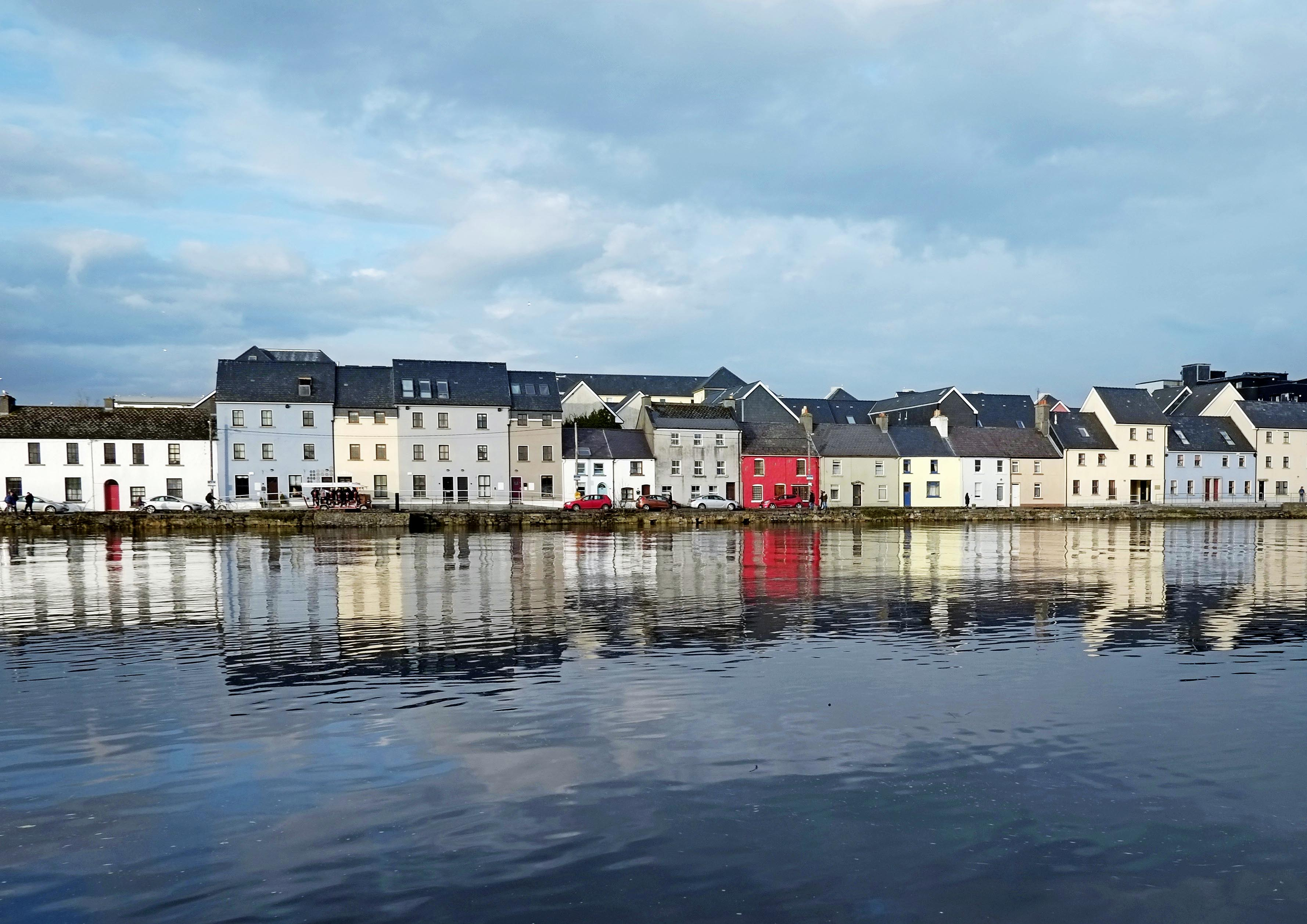A line of houses on the edge of the water