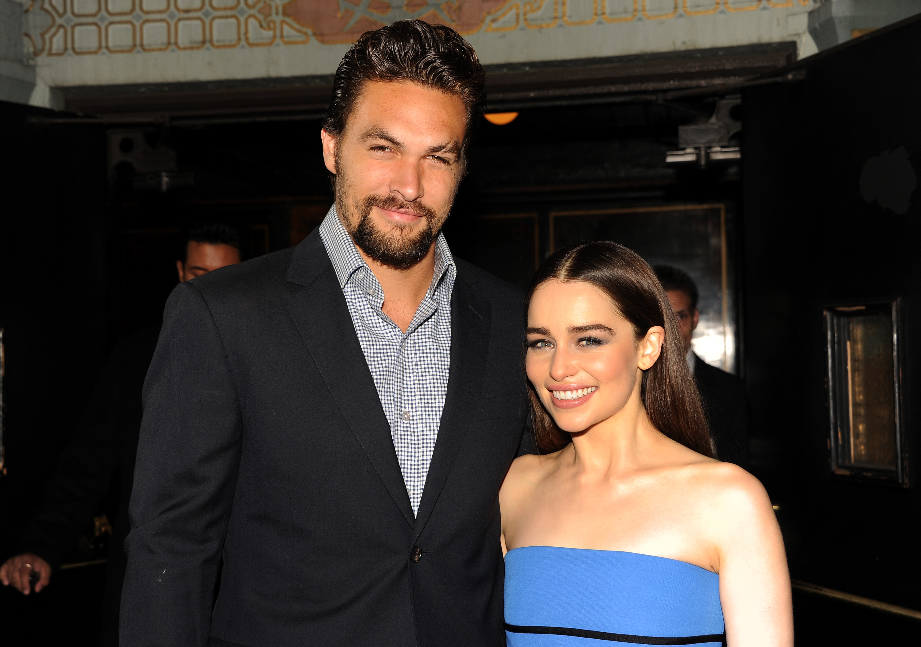 "HOLLYWOOD, CA - MARCH 18:  Actors Jason Momoa (L) and Emilia Clarke arrive at the premiere of HBO's ""Game Of Thrones"" Season 3 at TCL Chinese Theatre on March 18, 2013 in Hollywood, California.  (Photo by Kevin Winter/Getty Images, BA)"