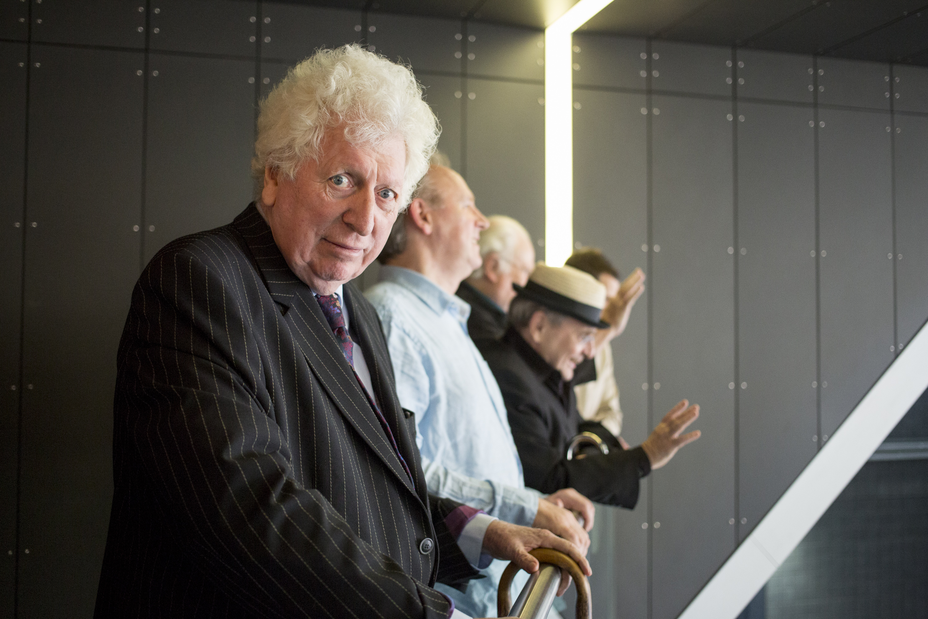 LONDON, ENGLAND - NOVEMBER 23:   Actor Tom Baker waits with four other previous Doctors from the classic series at the 'Doctor Who 50th Celebration' event in the ExCeL centre on November 22, 2013 in London, England. The sold-out three-day event in the ExCeL London convention centre celebrates 50 years of the show which has seen 11 actors play the role of Doctor Who and receives a worldwide cult following. Tom Baker played the role of the 'Doctor' from 1975 to 1981. (Photo by Dan Dennison/Getty Images)