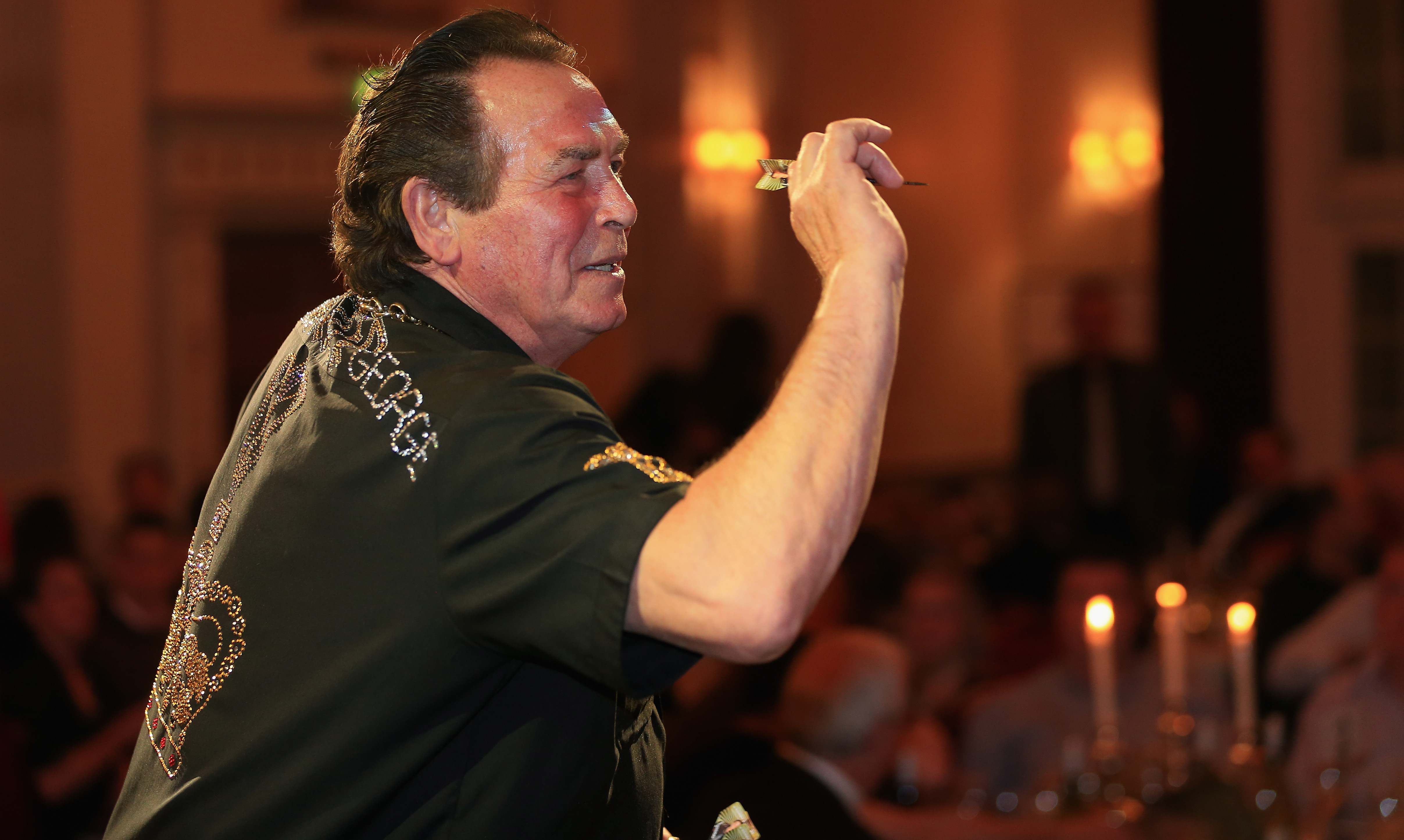 LONDON, ENGLAND - MAY 07: Bobby George, darts player, is pictured during the Pound 4 Pound Charity fundraiser for Fight4change on May 7, 2014 in London, England. (Photo by Andrew Redington/Getty Images, BA)